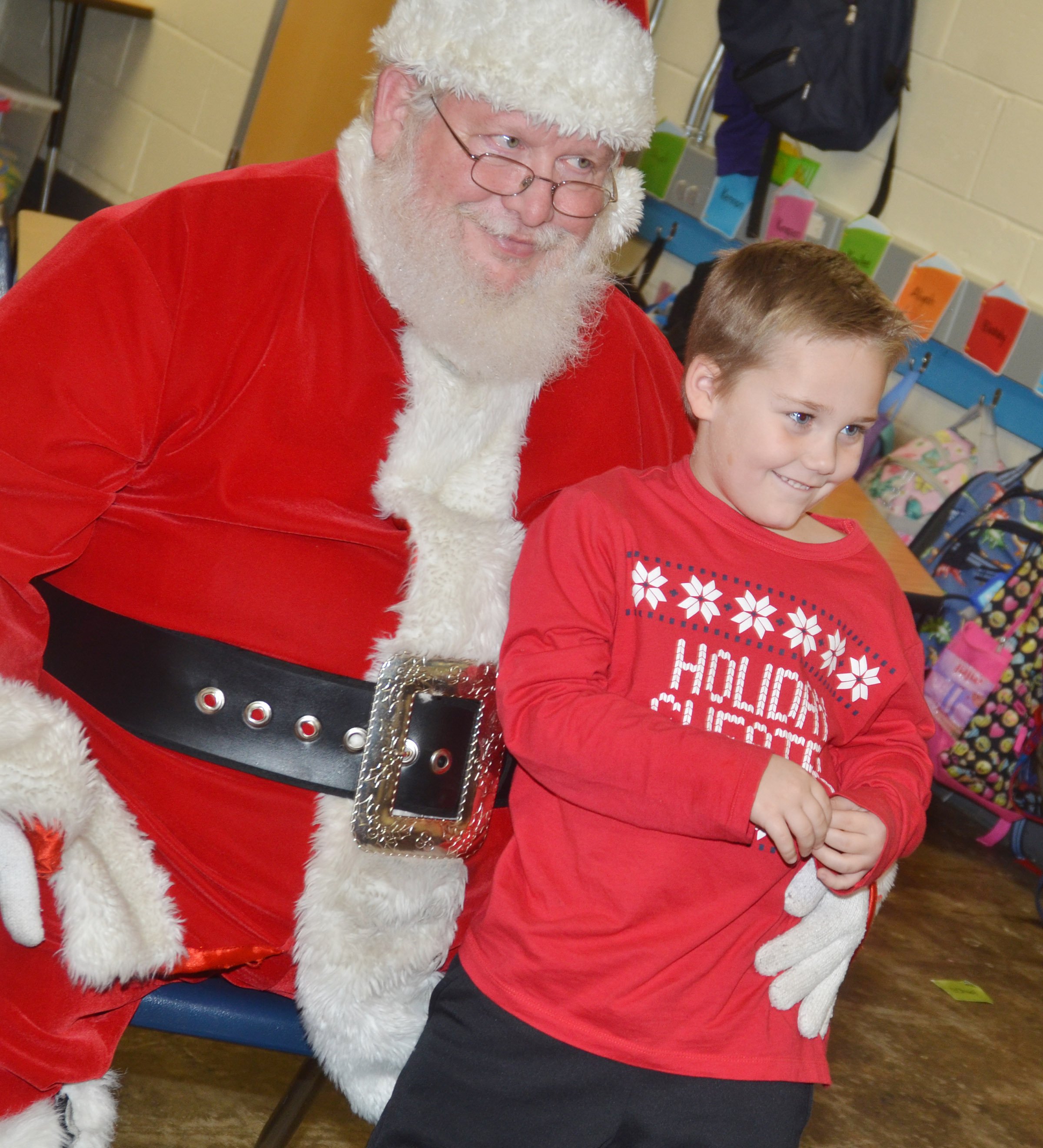 CES kindergartener Jacob Sandidge smiles for a photo with Santa.