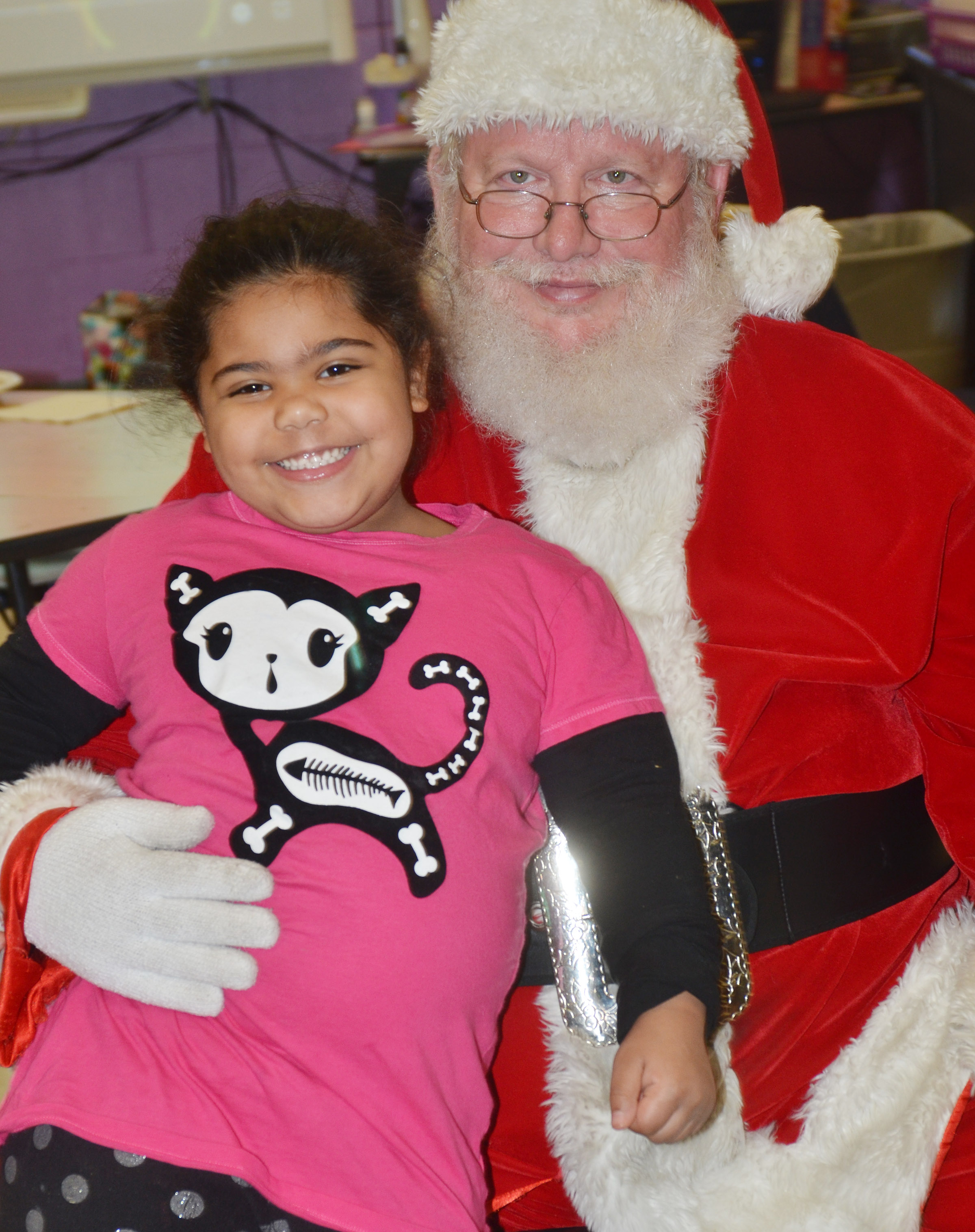 CES kindergartener Linnly Adams poses for a photo with Santa.
