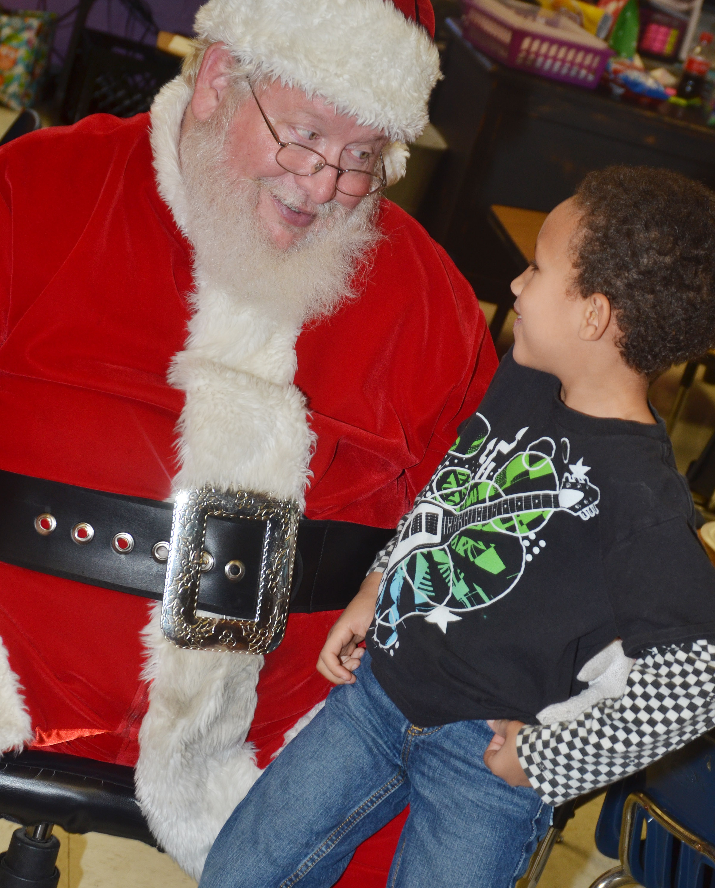 CES kindergartener Jaxon Williams talks to Santa.