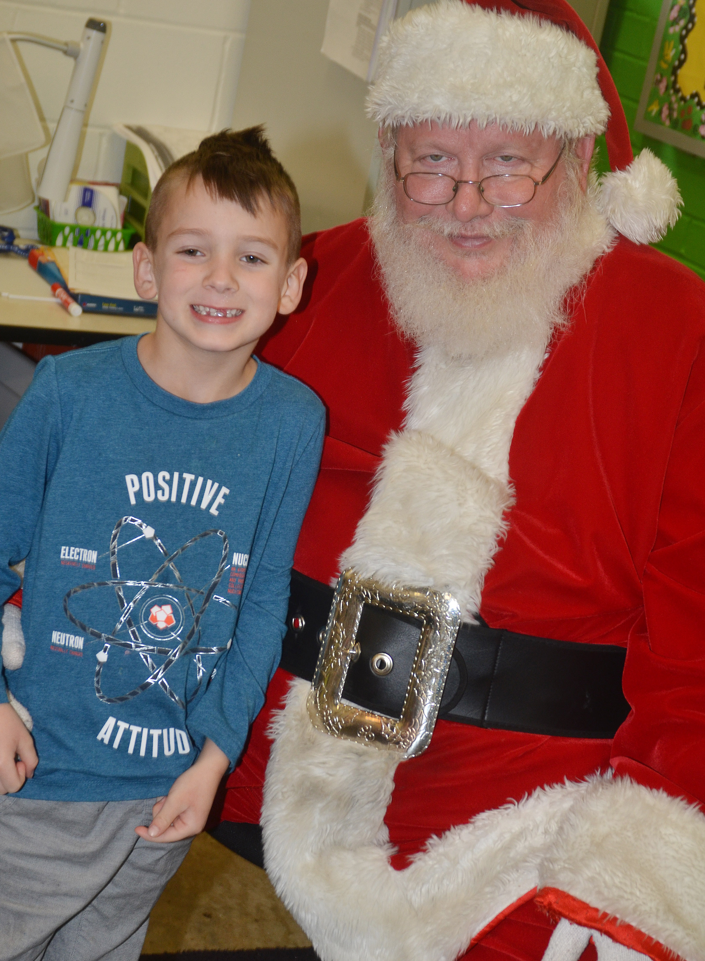 CES kindergartener Cash Davis smiles for a photo with Santa.