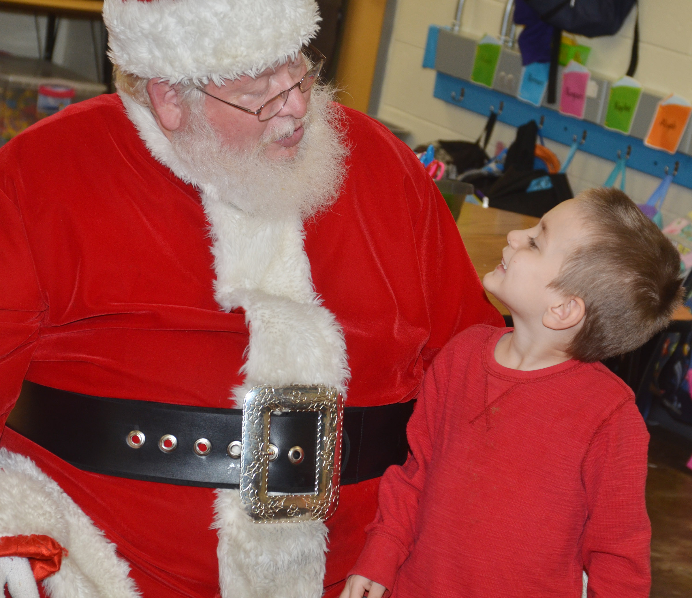 CES kindergartener Samuel Terry talks to Santa.