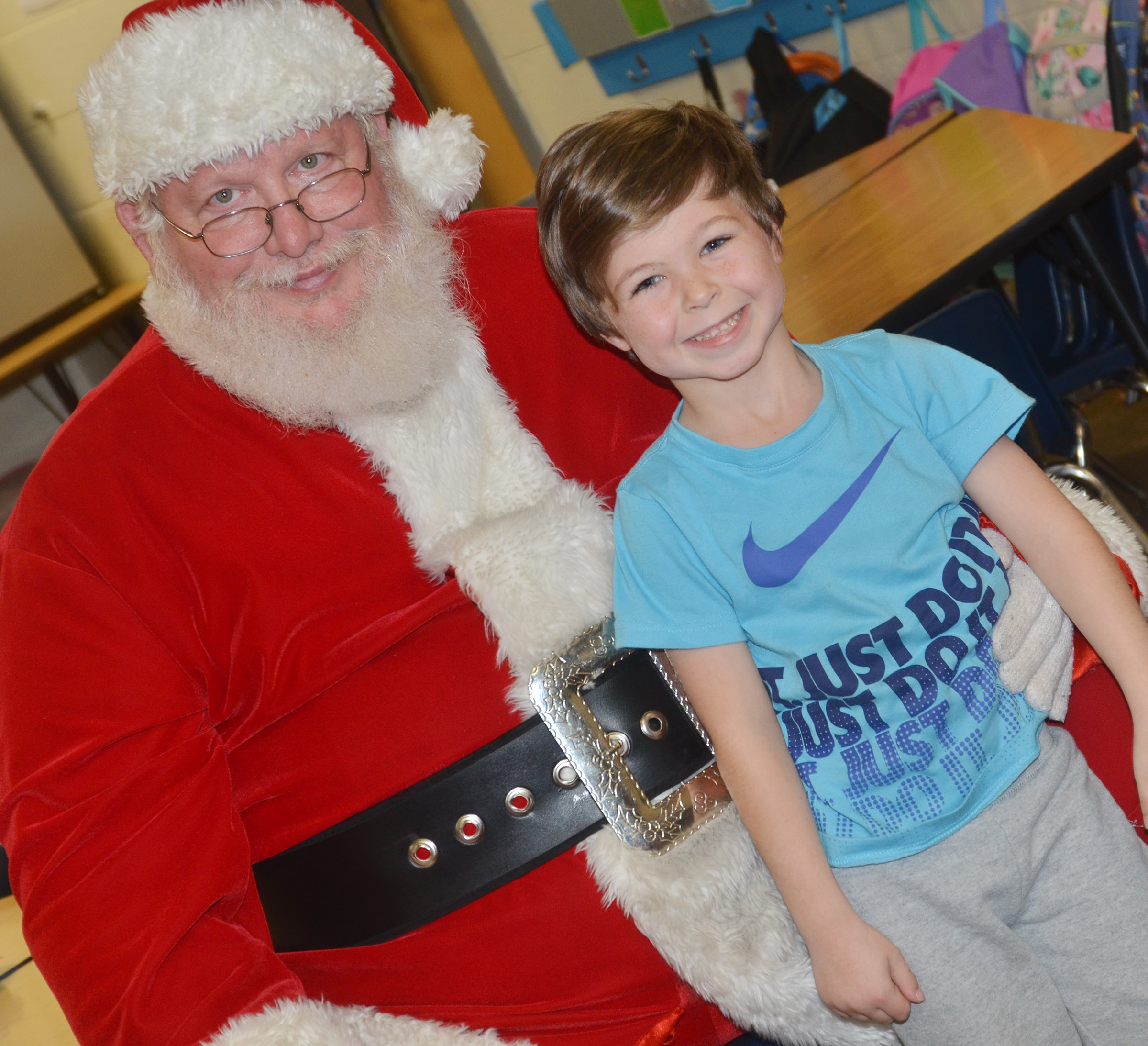 CES kindergartener Bentley Wilhoite smiles for a photo with Santa.