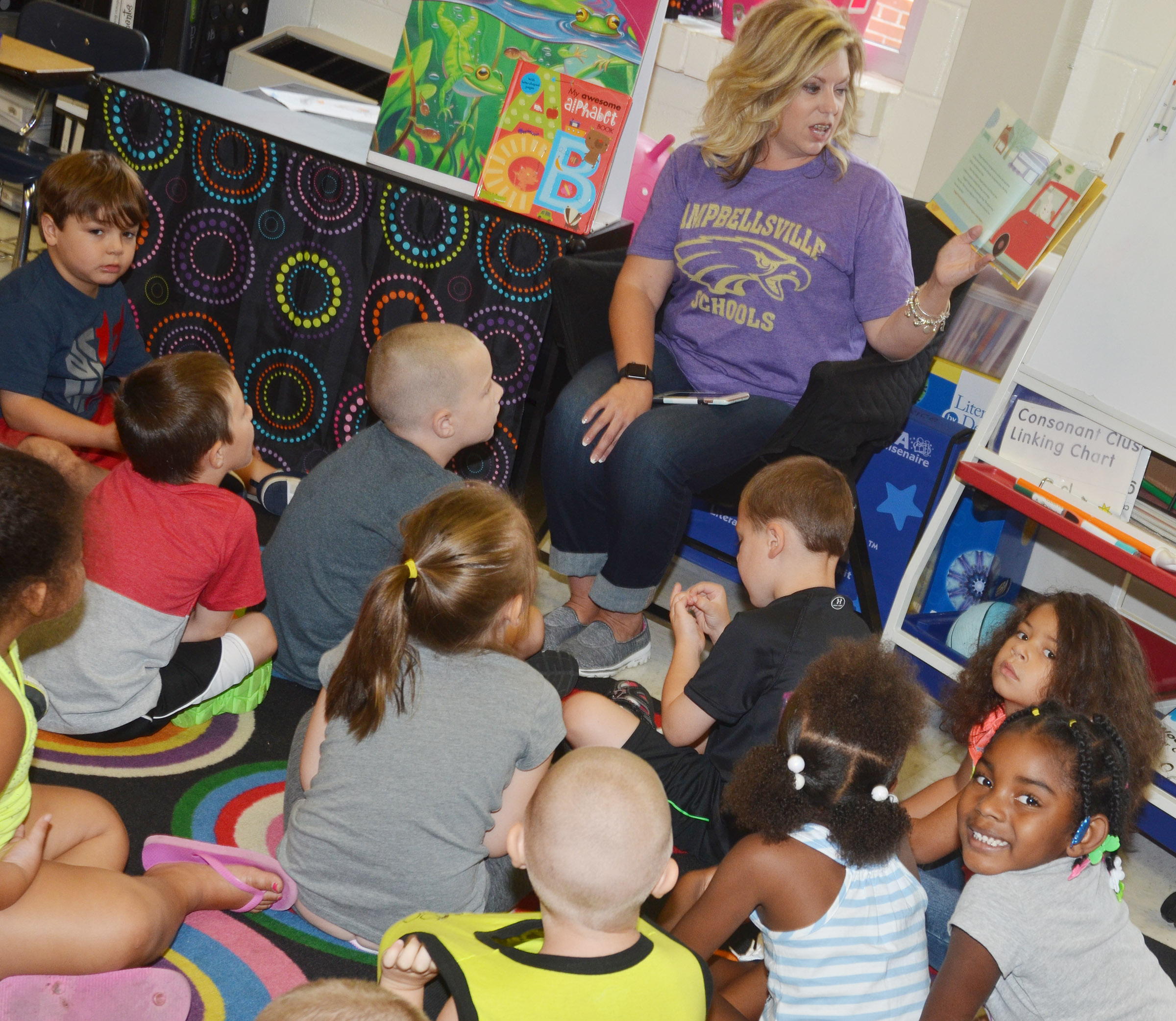 "CES kindergarten teacher Nikki Price reads ""Nugget's First Day of School"" to her students."