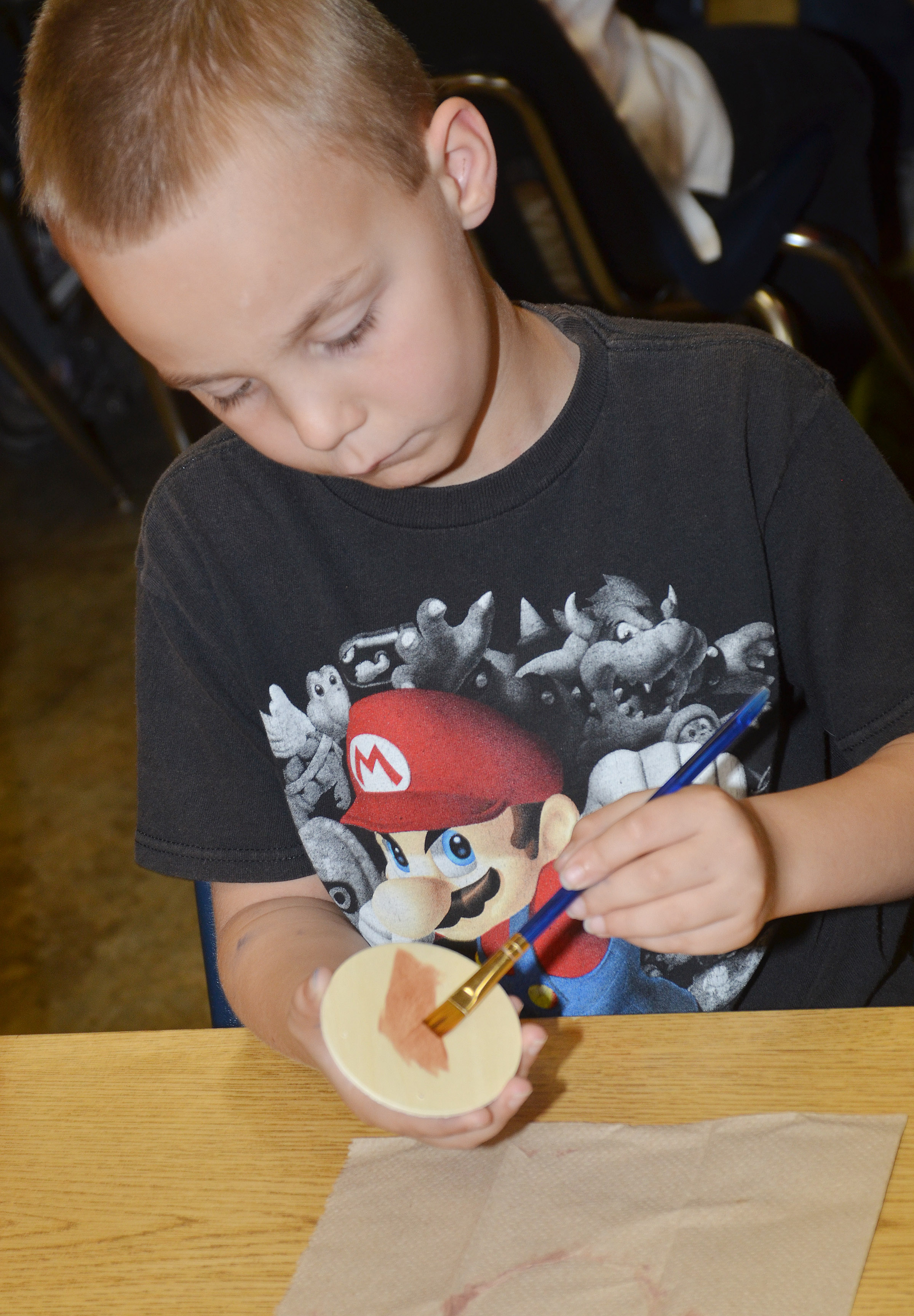 CES second-grader Hunter Bates paints his reindeer ornament.