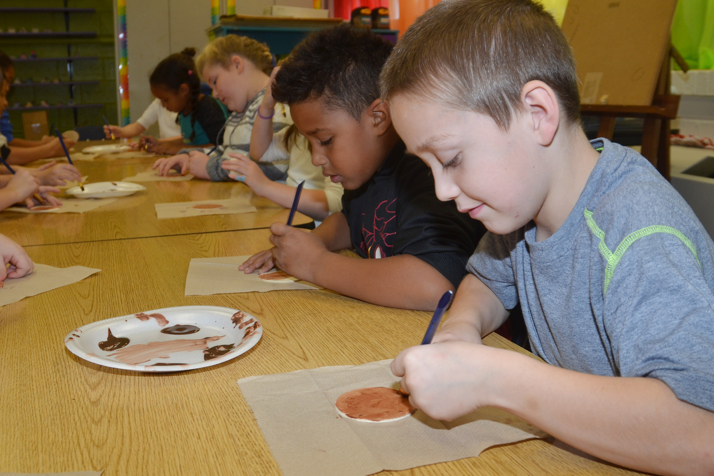 CES second-grader Jacob Golden paints his reindeer ornament with his classmates.