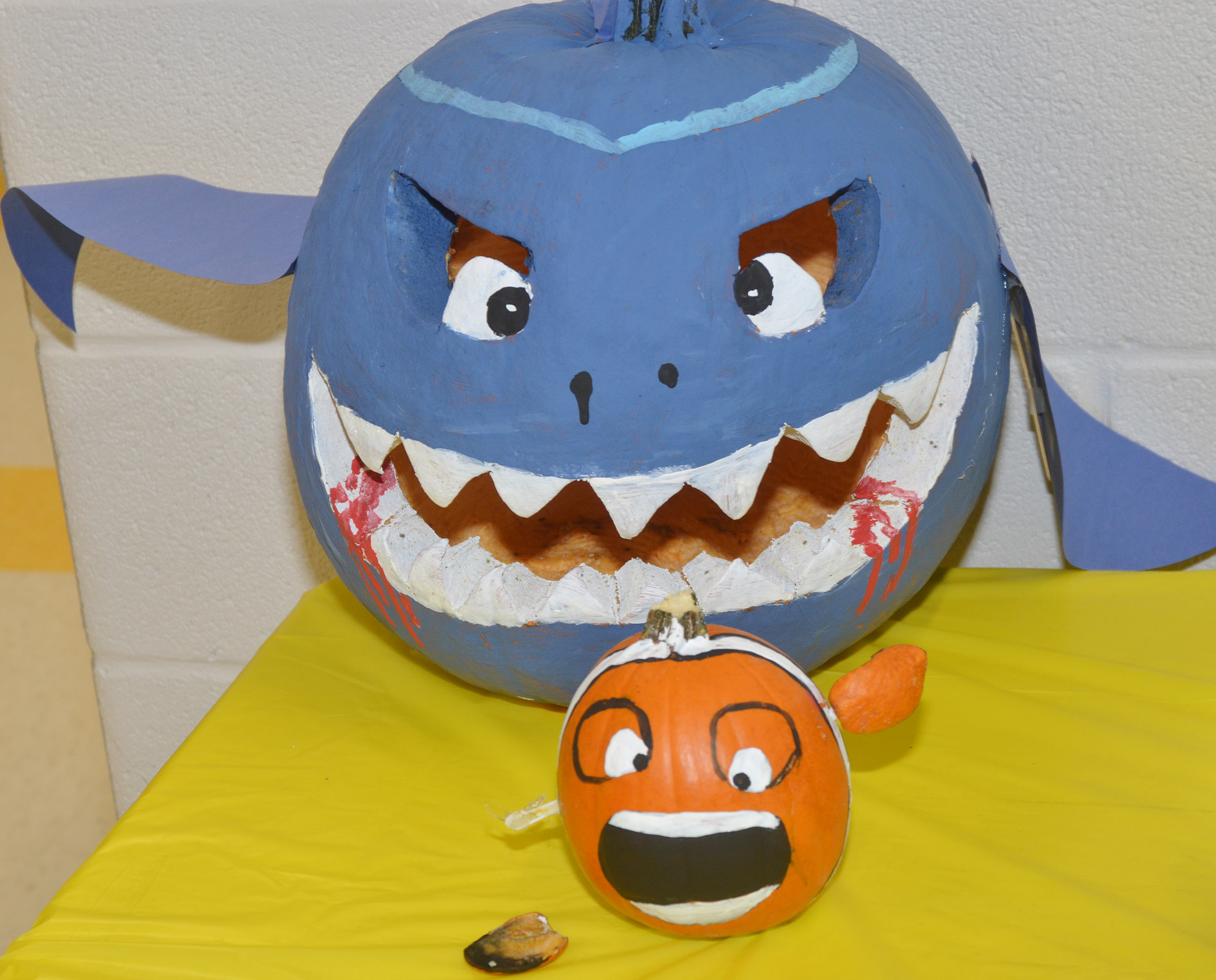 CES teachers are competing in a pumpkin decorating contest to raise money for cystic fibrosis research. The entries, above, are featured in the CES lobby. Votes cost a penny each and money can be submitted to the CES office.