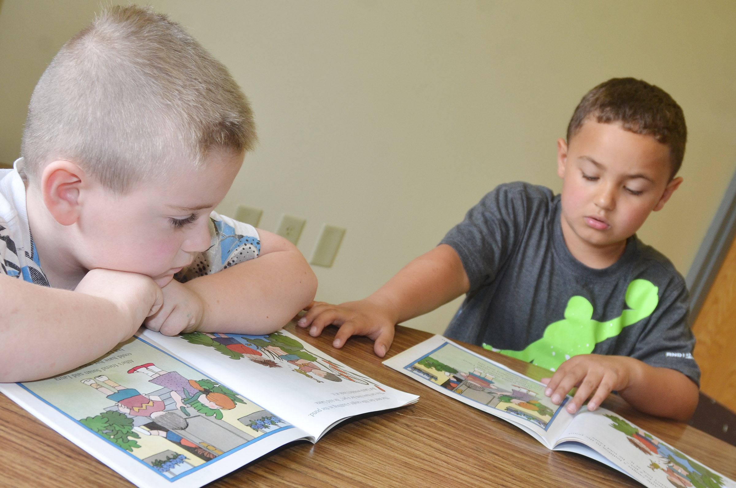 CES first-graders Drake Edwards, at left, and Marion Mann read together.
