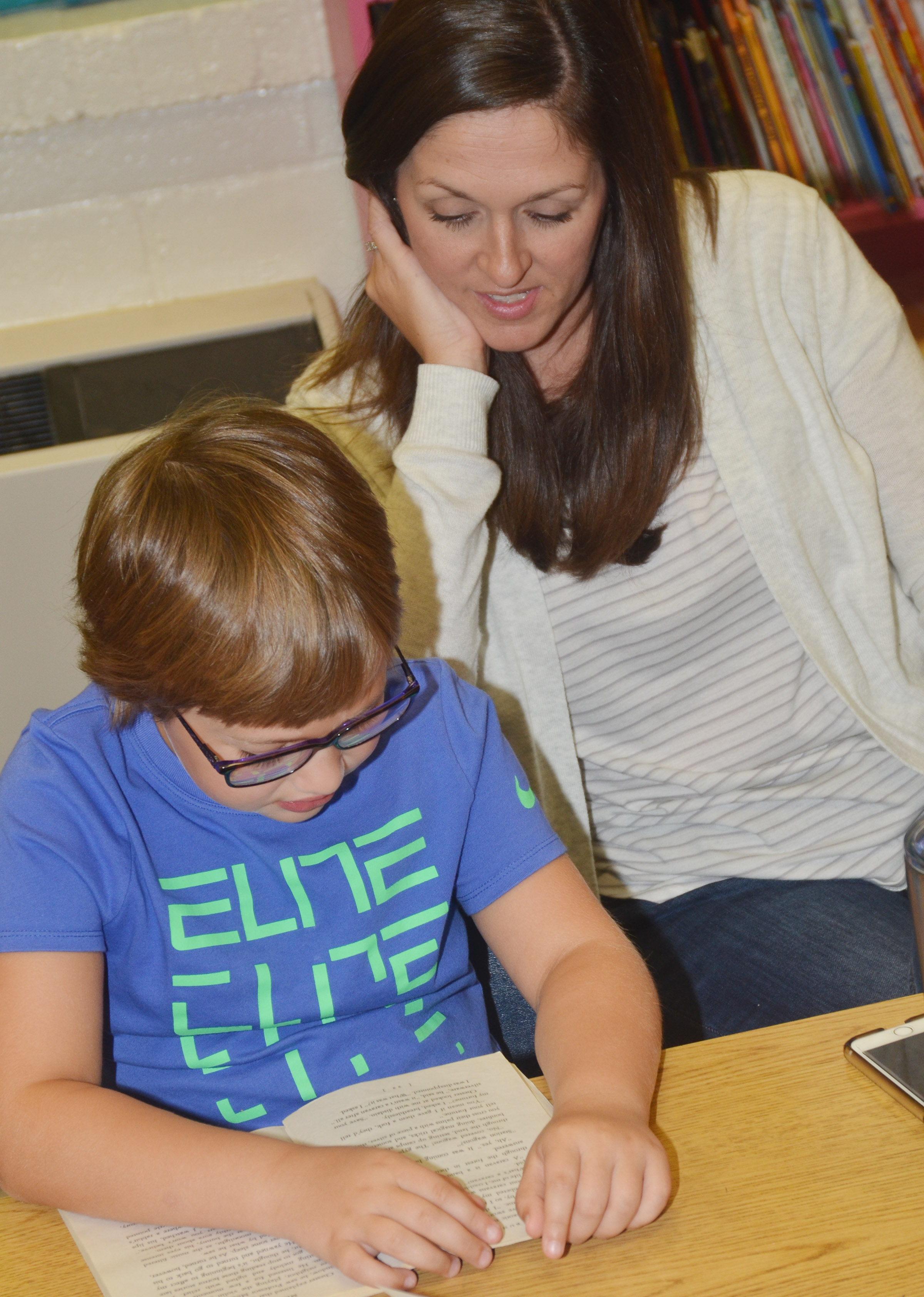 CES art teacher Adrienne Hash listens as second-grader Addelyn Dooley reads.