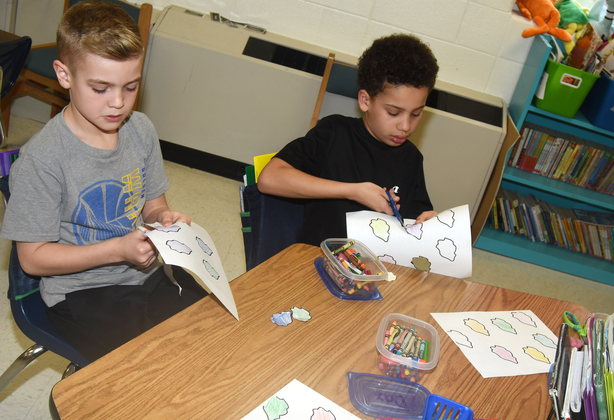 CES second-graders Dax Gray, at left, and Bryant Mayo cut out their paint splotches as they create their prefix palates.