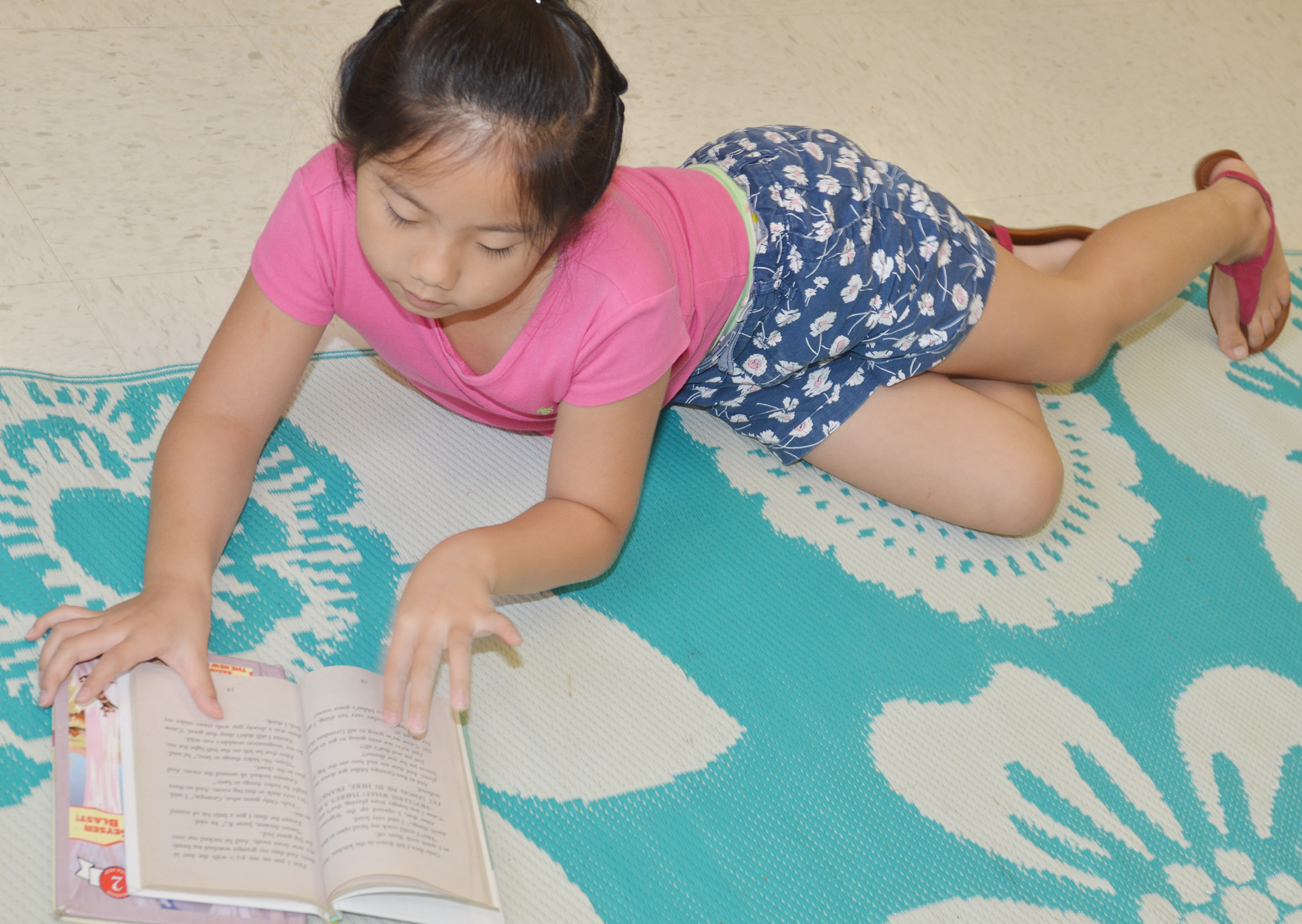 CES second-grader Tina Jiang reads a chapter book.