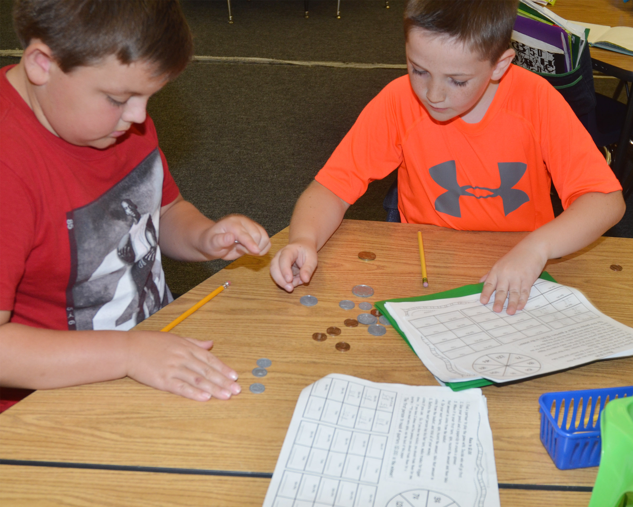 CES second-graders Hayden Maupin, at left, and Luke Adkins play a game to see how well they can count money.