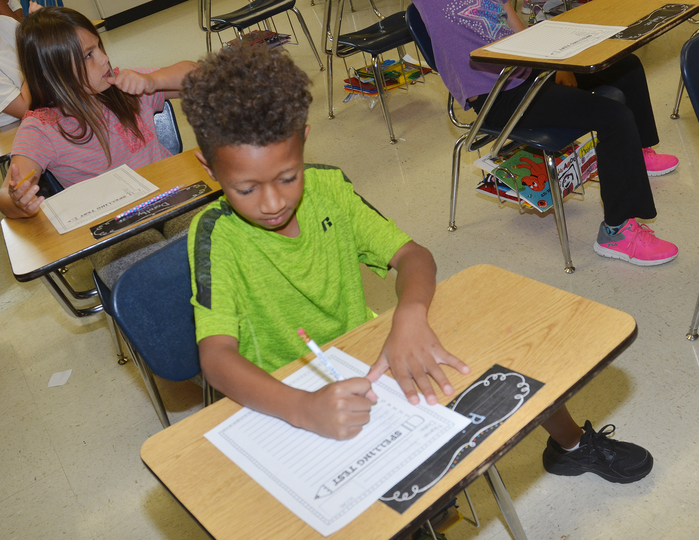 CES third-grader Rajon Taylor writes a spelling word.