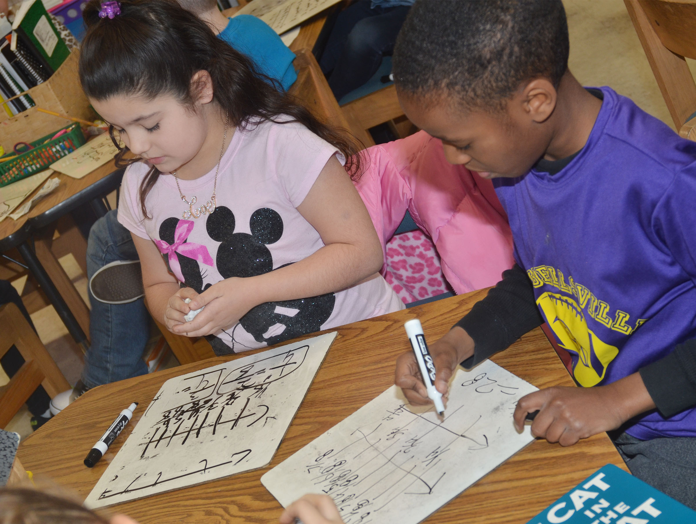 CES third-graders Brooklyn Boudreaux, at left, and John Gholston add fractions.
