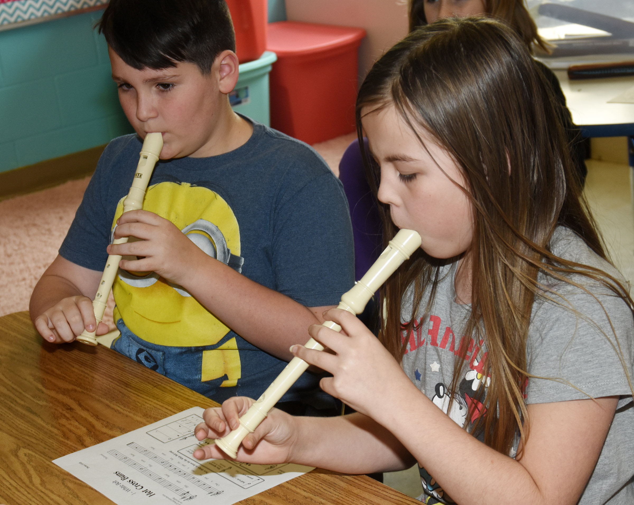 CES fourth-graders Ethan Garrison, at left, and Chloe Bates play Hot Cross Buns.
