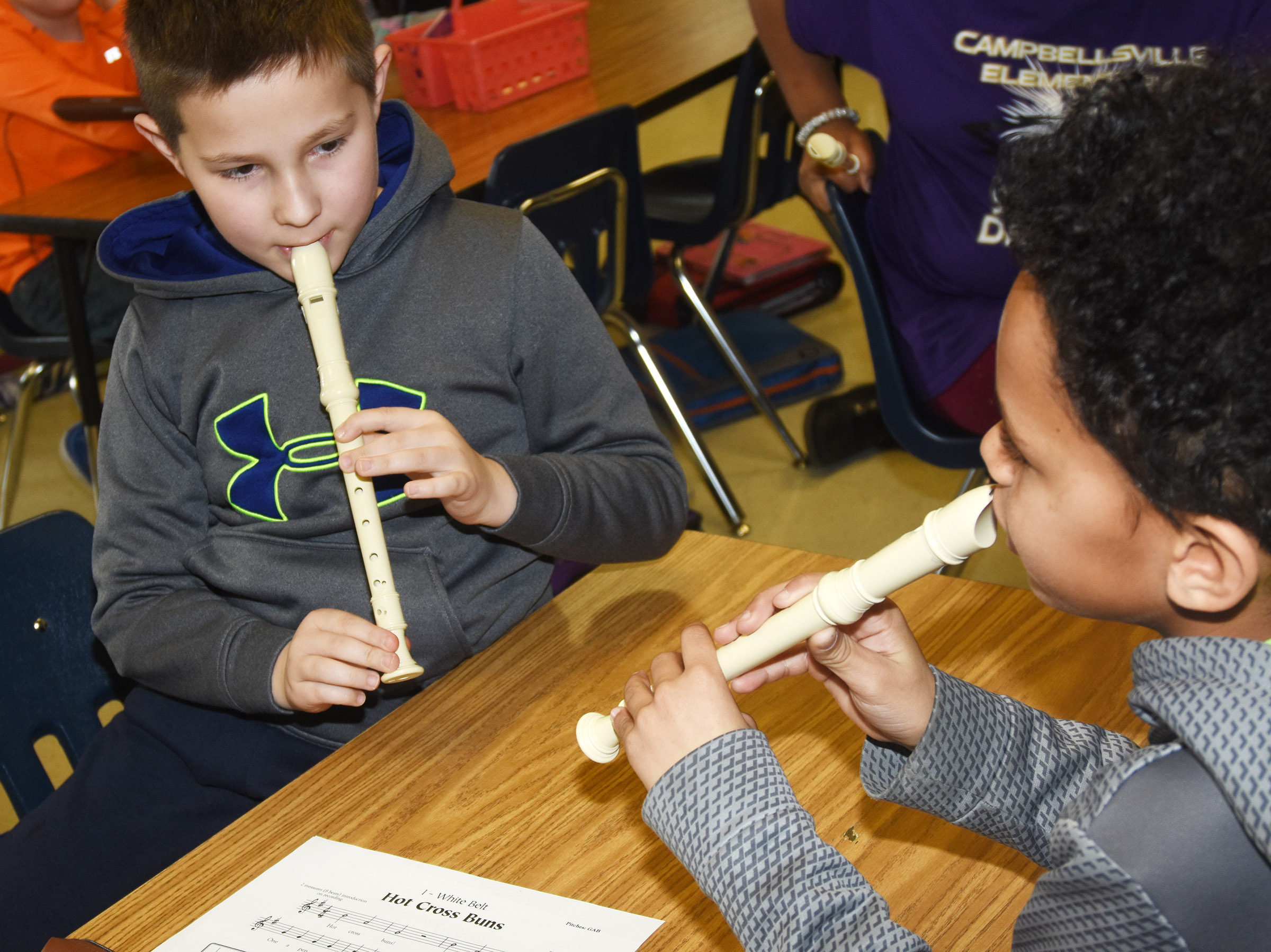CES fourth-graders Grayson Dooley, at left, and Anthony Goins play Hot Cross Buns.