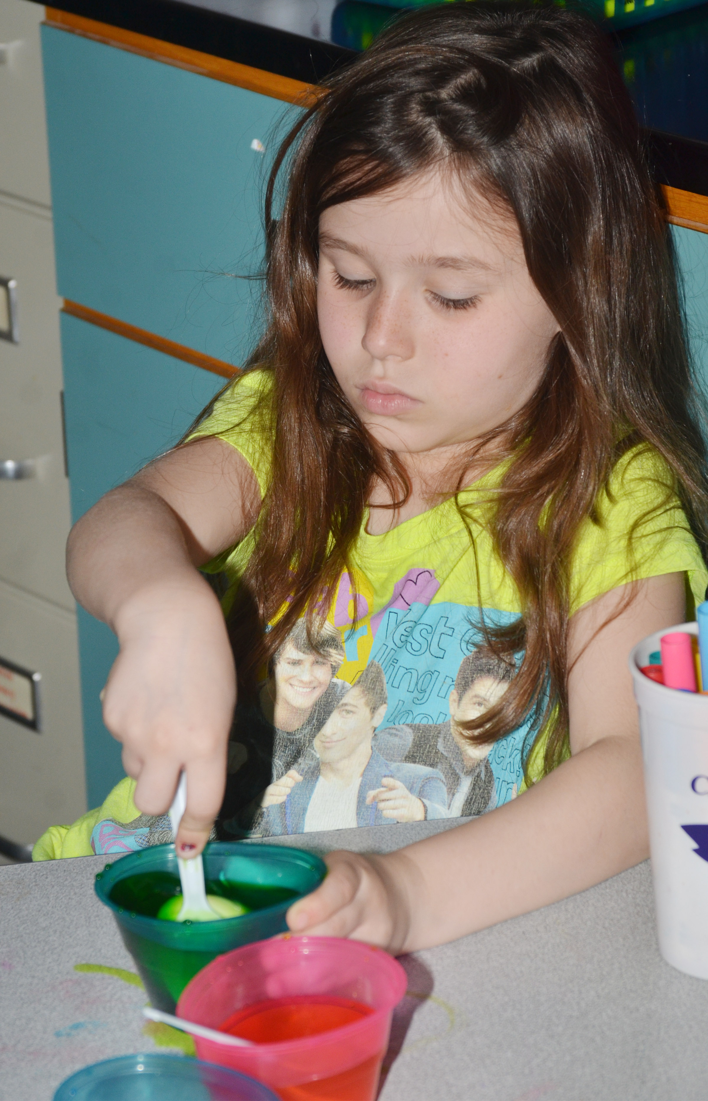 CES first-grader Stella Newcomb dyes her Easter eggs.