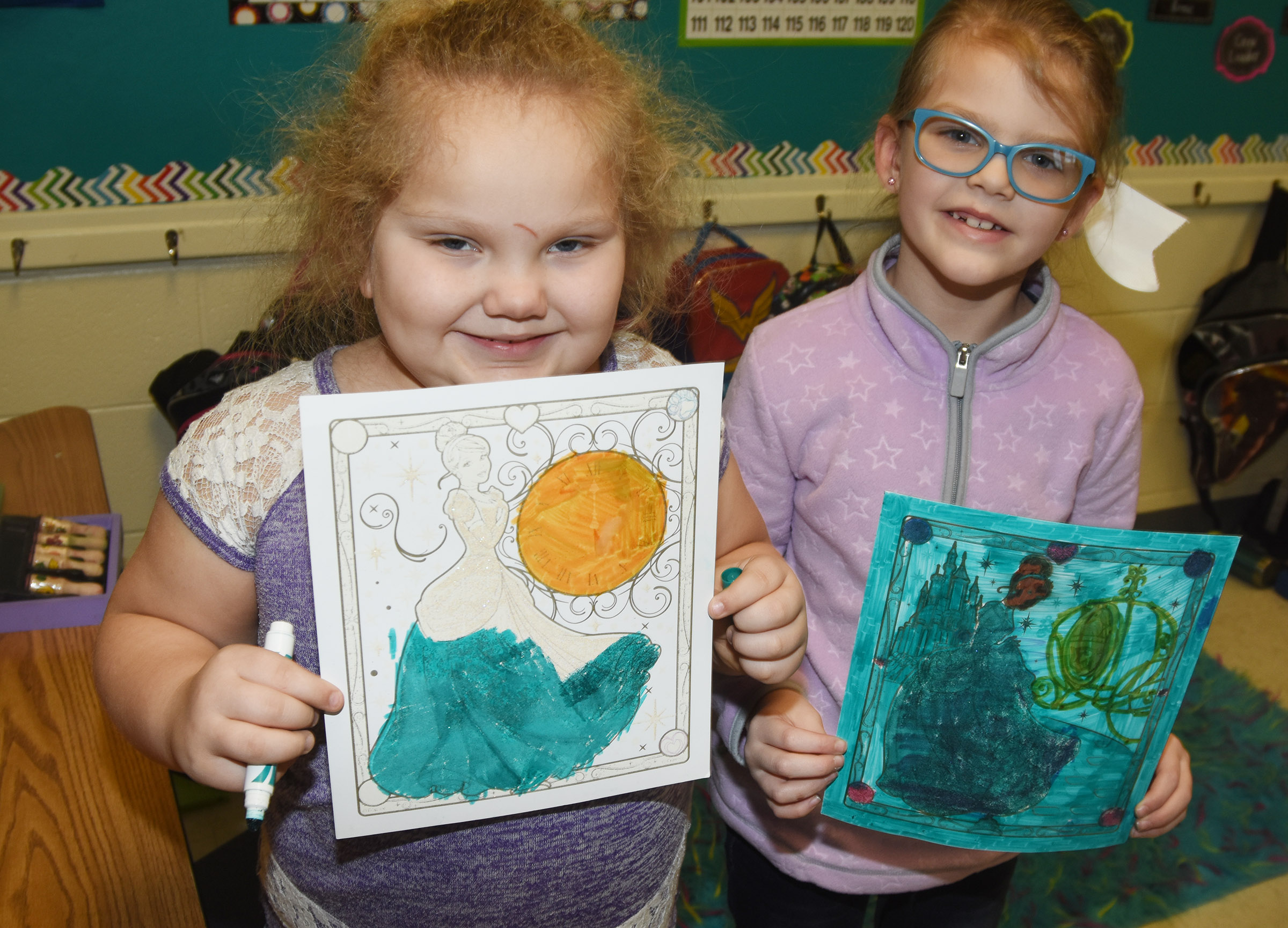 CES first-graders ReAnna Jeffries, at left, and Zoe Weddle have fun coloring together.
