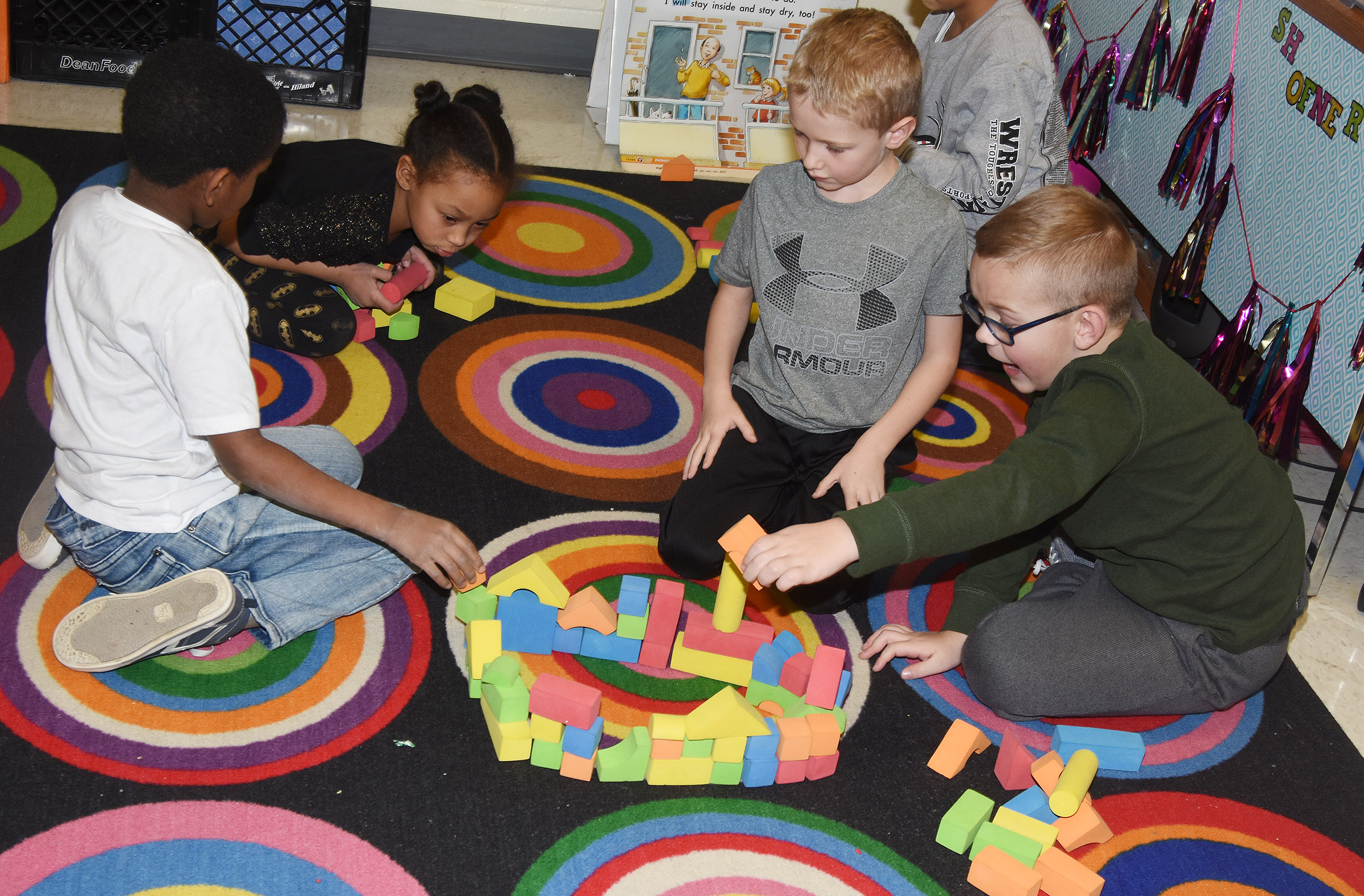 CES first-graders build together with blocks. From left are Kasen Smith, Aleja Taylor, Jackson Wright and John Hagan Newton.