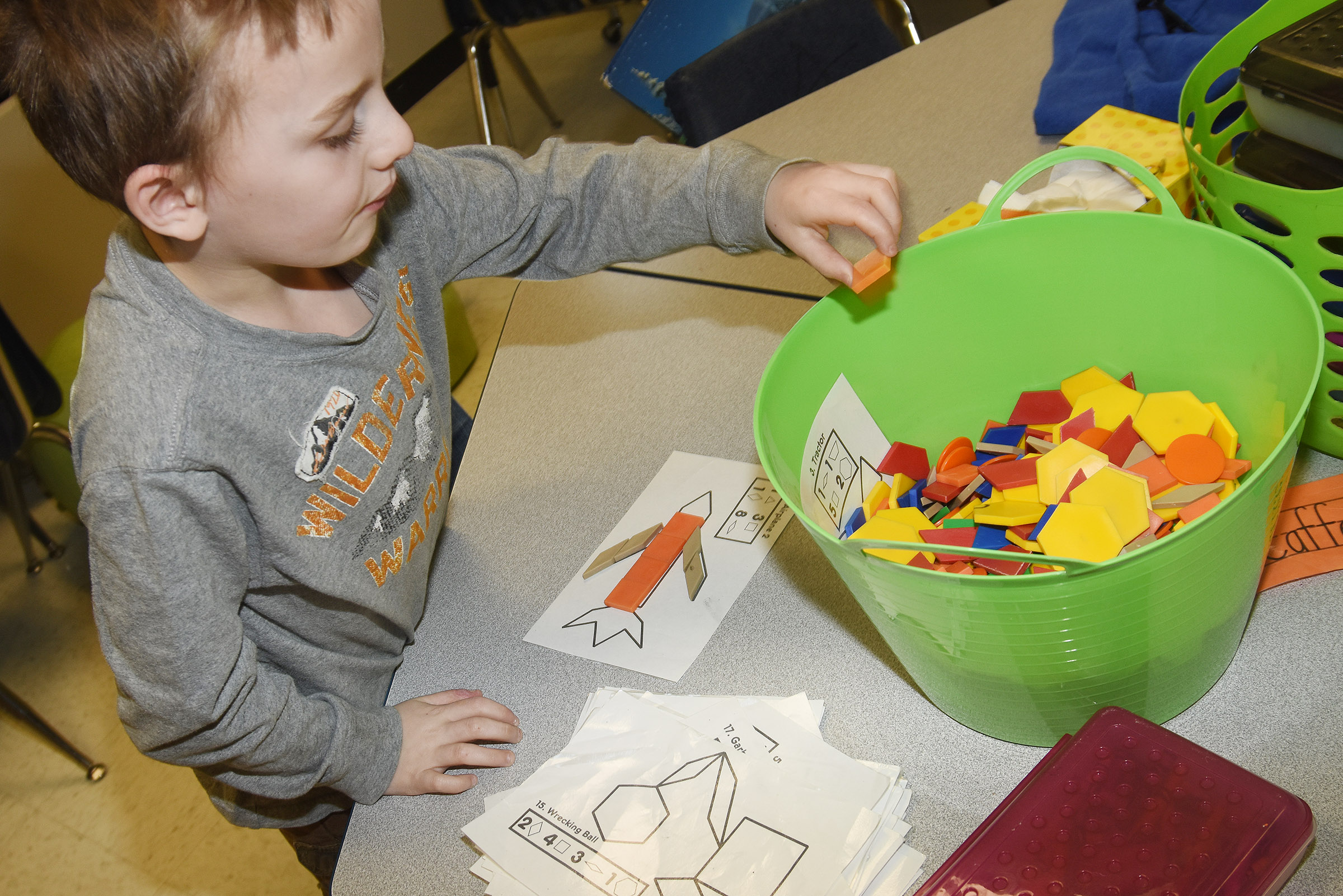 CES first-grader Ronnie Allen builds an airplane with shapes.