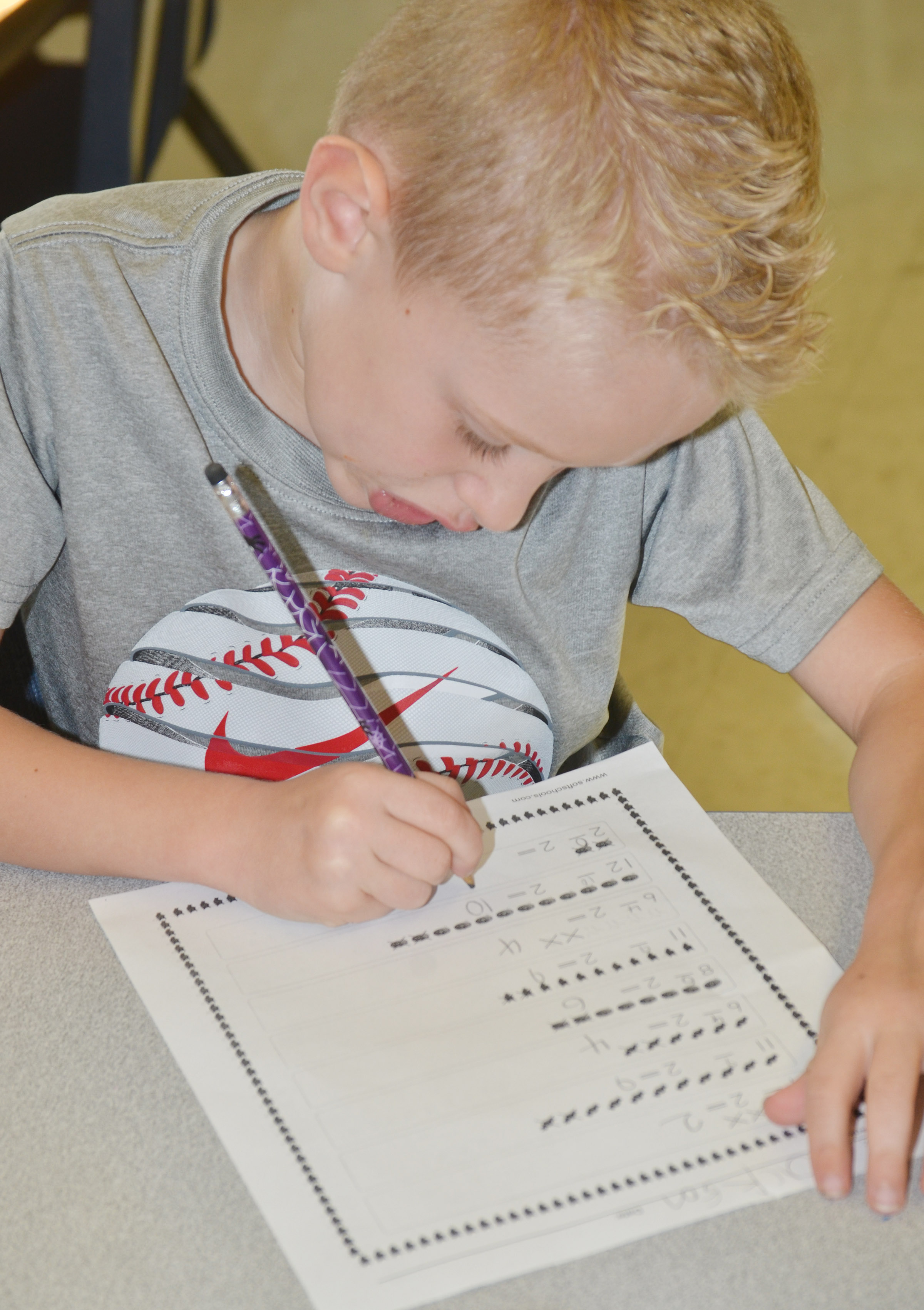 CES first-grader Jackson Wright works a subtraction problem.
