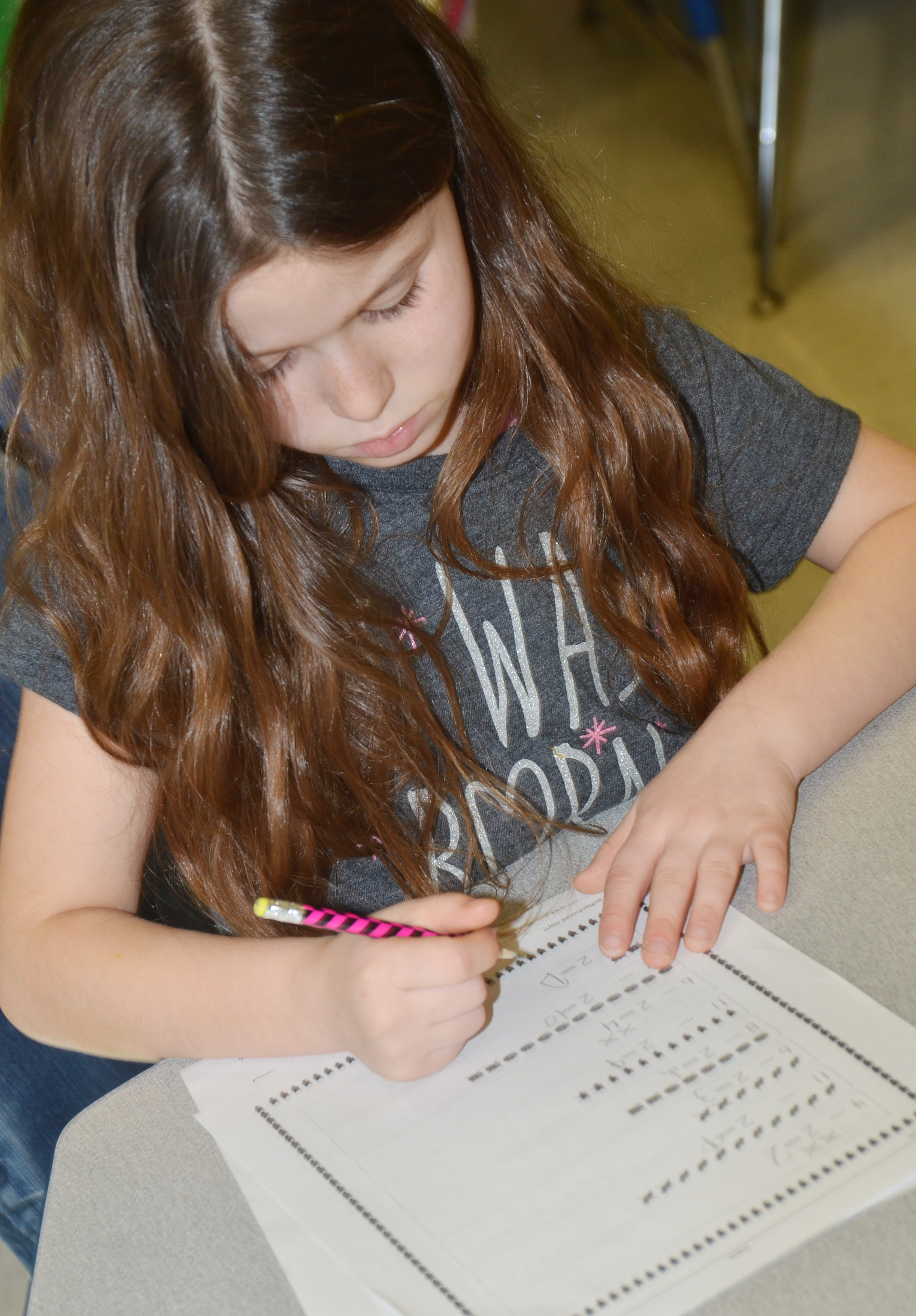 CES first-grader Stella Newcomb works a subtraction problem.