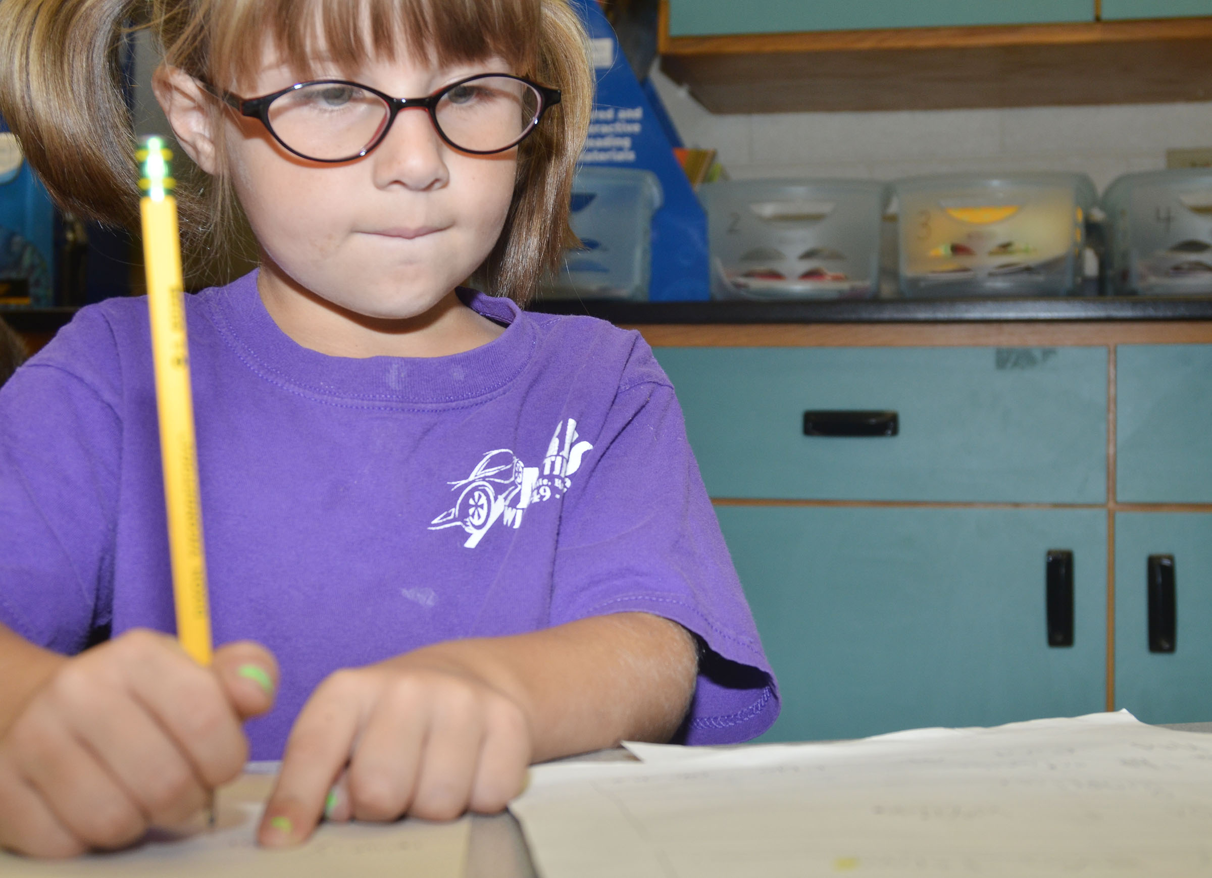 CES first-grader Kenady Gabehart works on writing sentences.