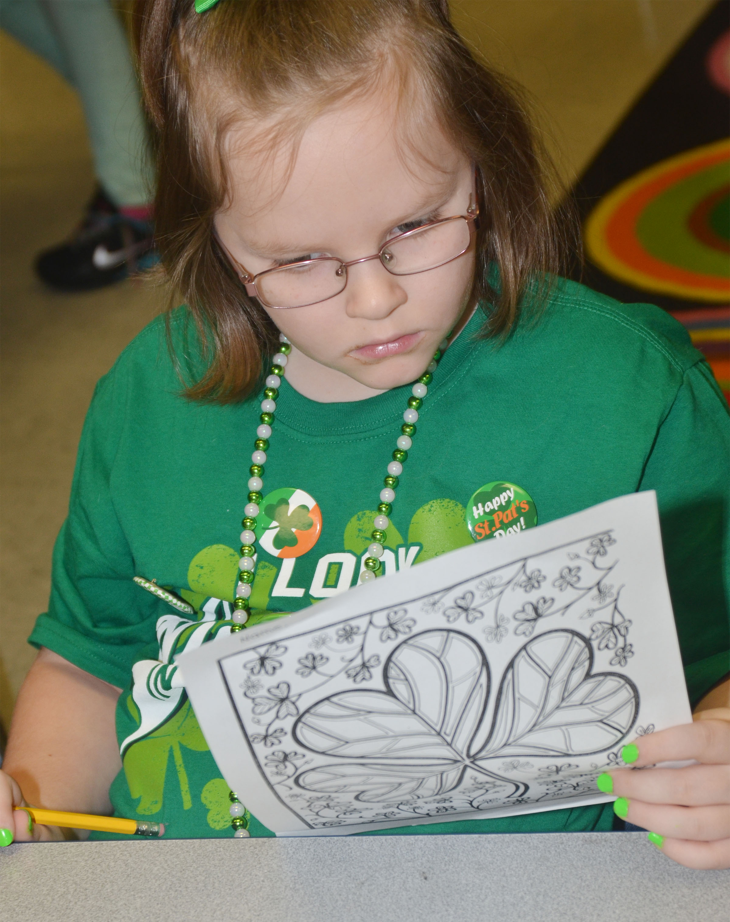 CES first-grader Justice Albrecht works a St. Patrick's Day-themed word search puzzle.