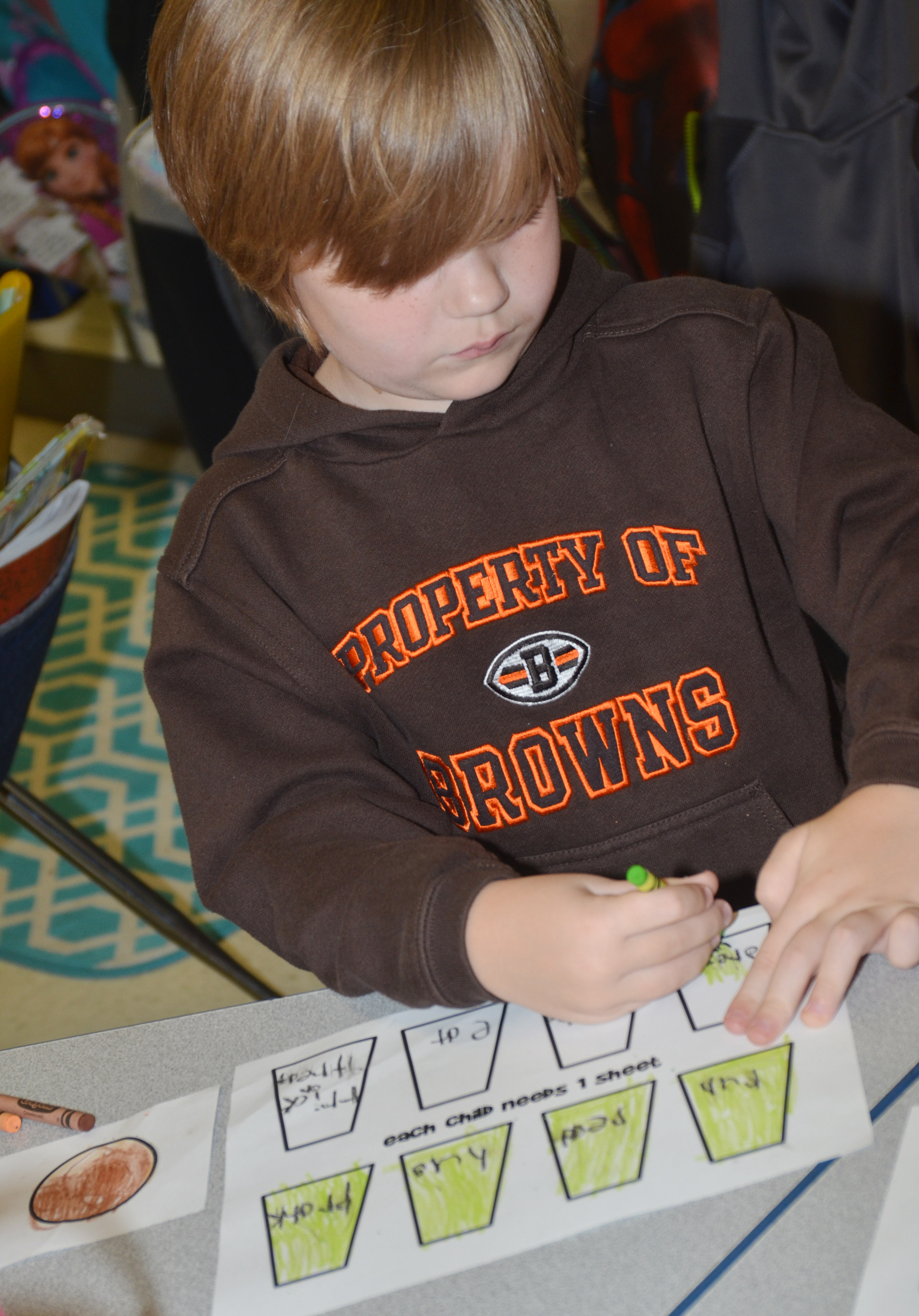 CES first-grader Gavin Williams colors his verbs.