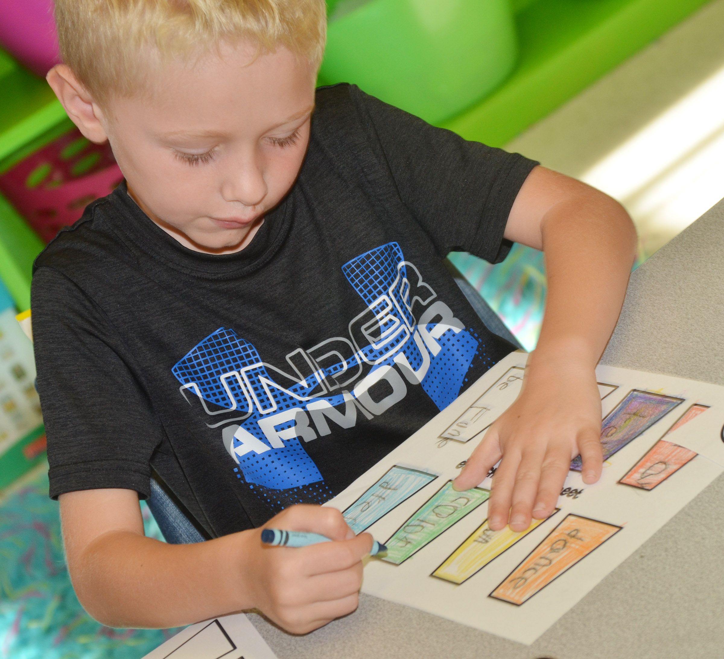 CES first-grader Jackson Wright colors his verbs.