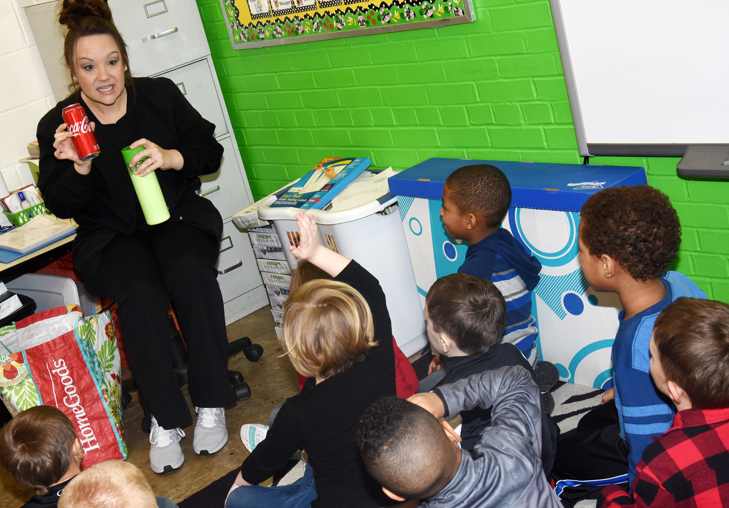 Dental hygienist Brandie Sharp, who works at Dr. John Smoot's dental office in Campbellsville, talks to CES kindergarteners about how much sugar is in soda.