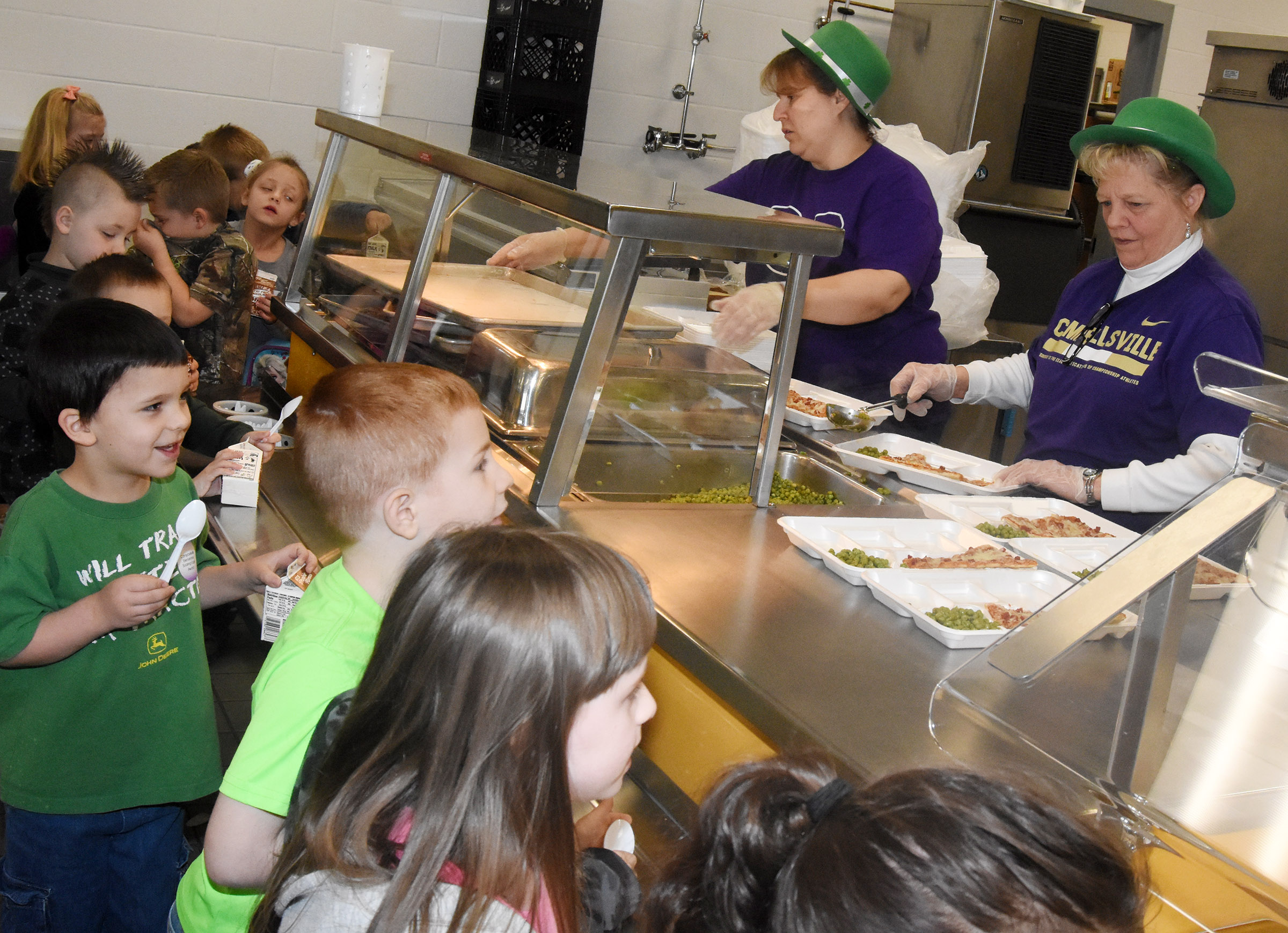Leprechauns serve lunch to CES kindergarteners.