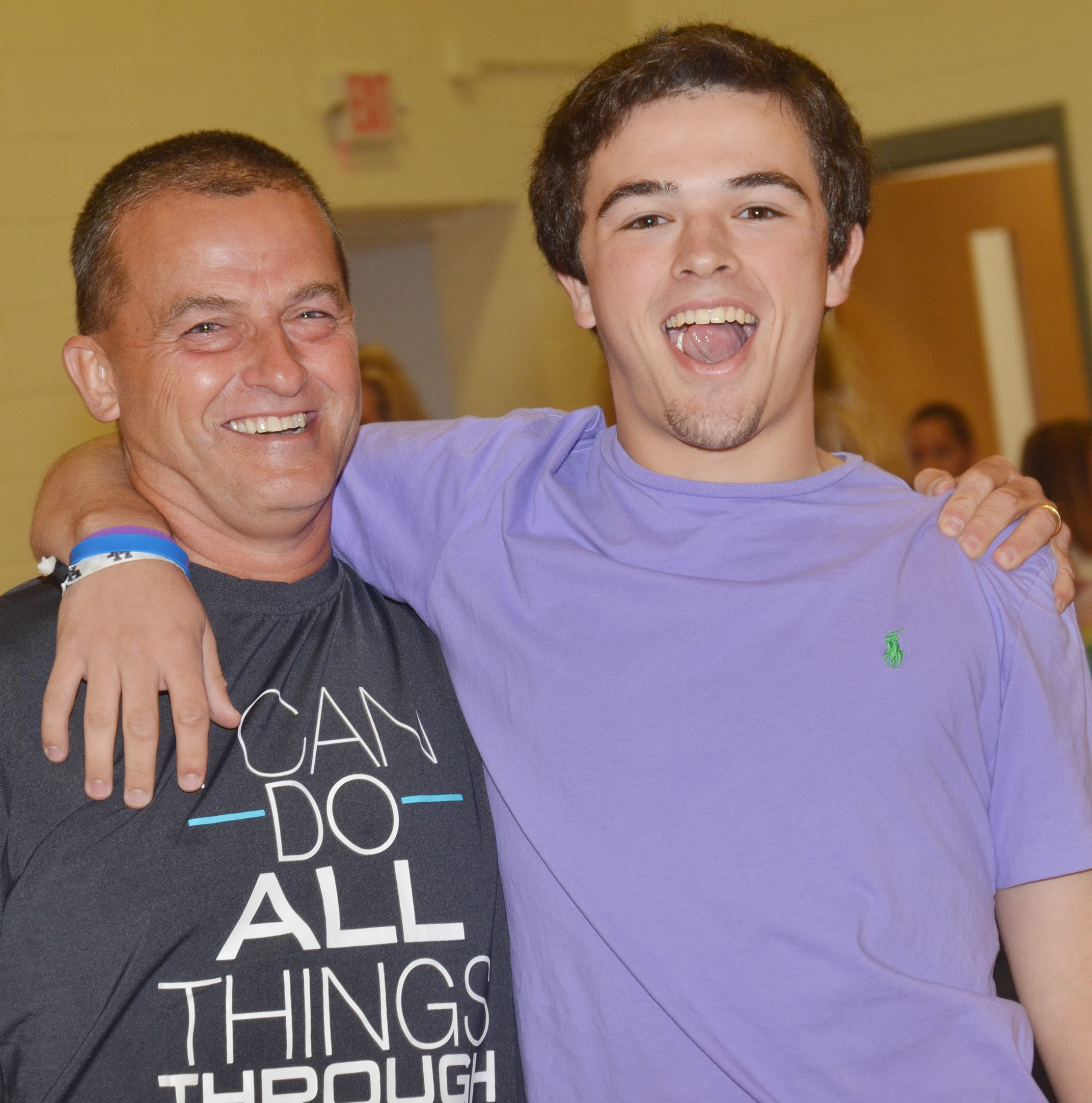 Lynn Kearney smiles with his son, Ryan, who is a junior at Campbellsville High School.