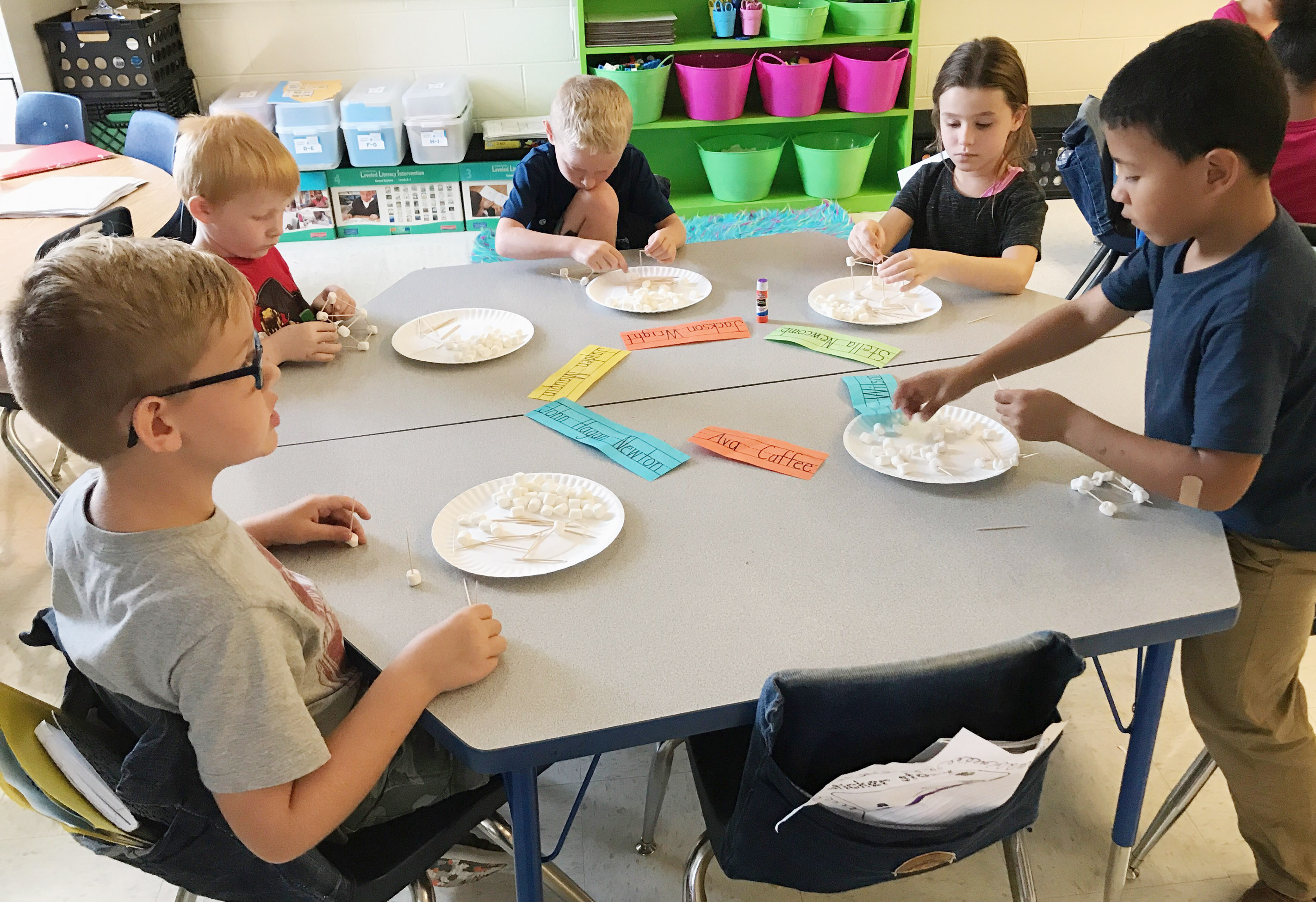 CES first-graders, from left, John Hagan Newton, Jayden Maupin, Jackson Wright, Stella Newcomb and Ahryan Wilson build their marshmallow structures.