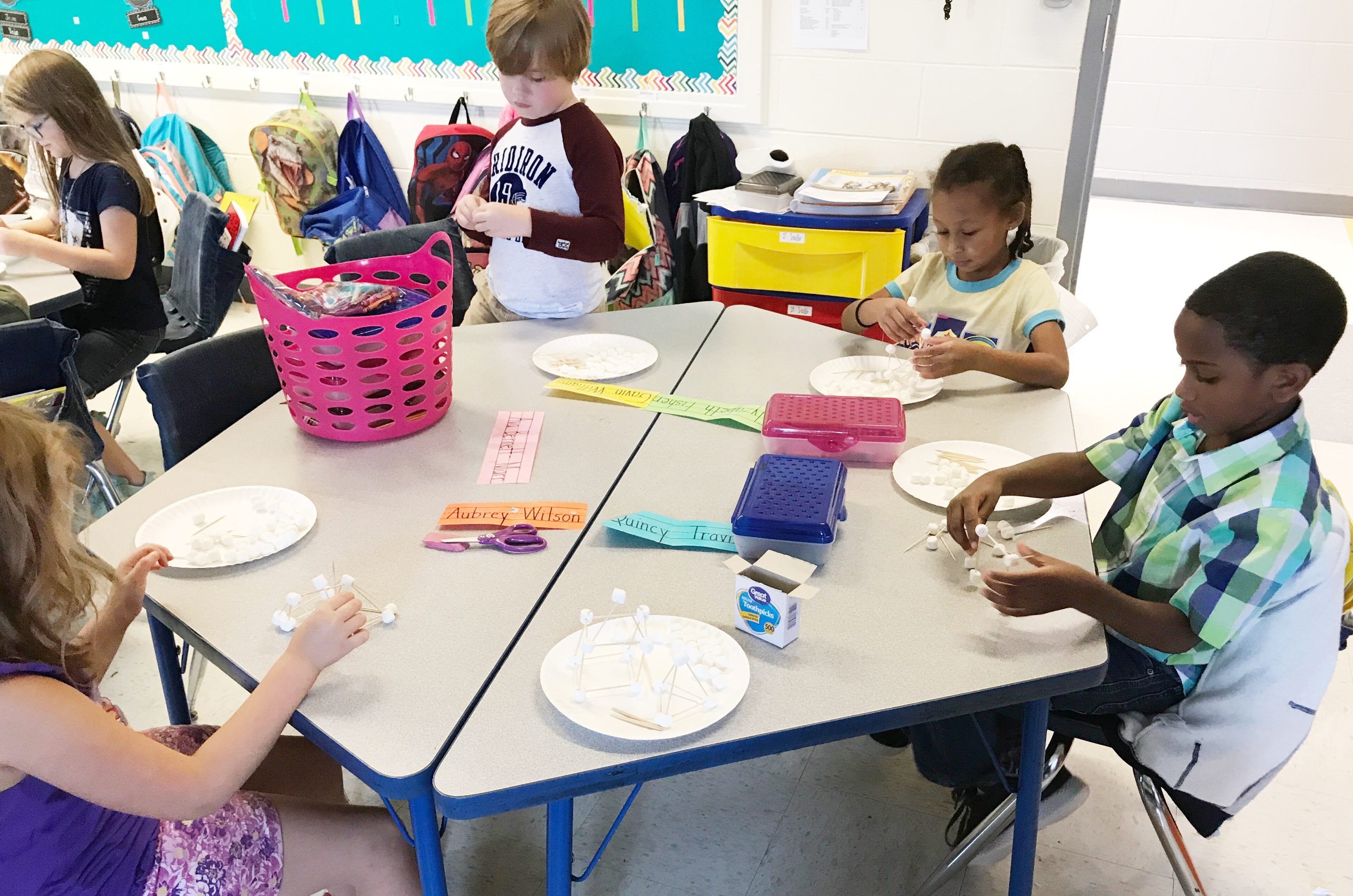 From left, CES first-graders Gavin Williams, Elyzabeth Fisher and Kasen Smith build their marshmallow structures.