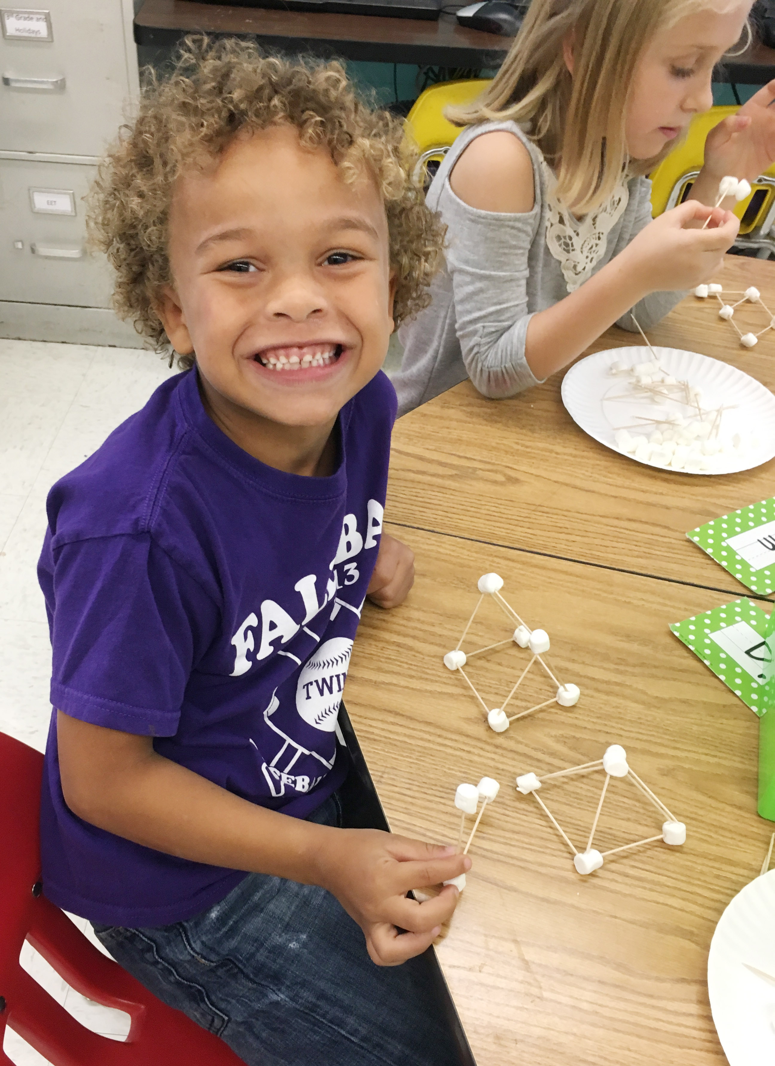 CES first-grader Dyra Welch builds his marshmallow structure.