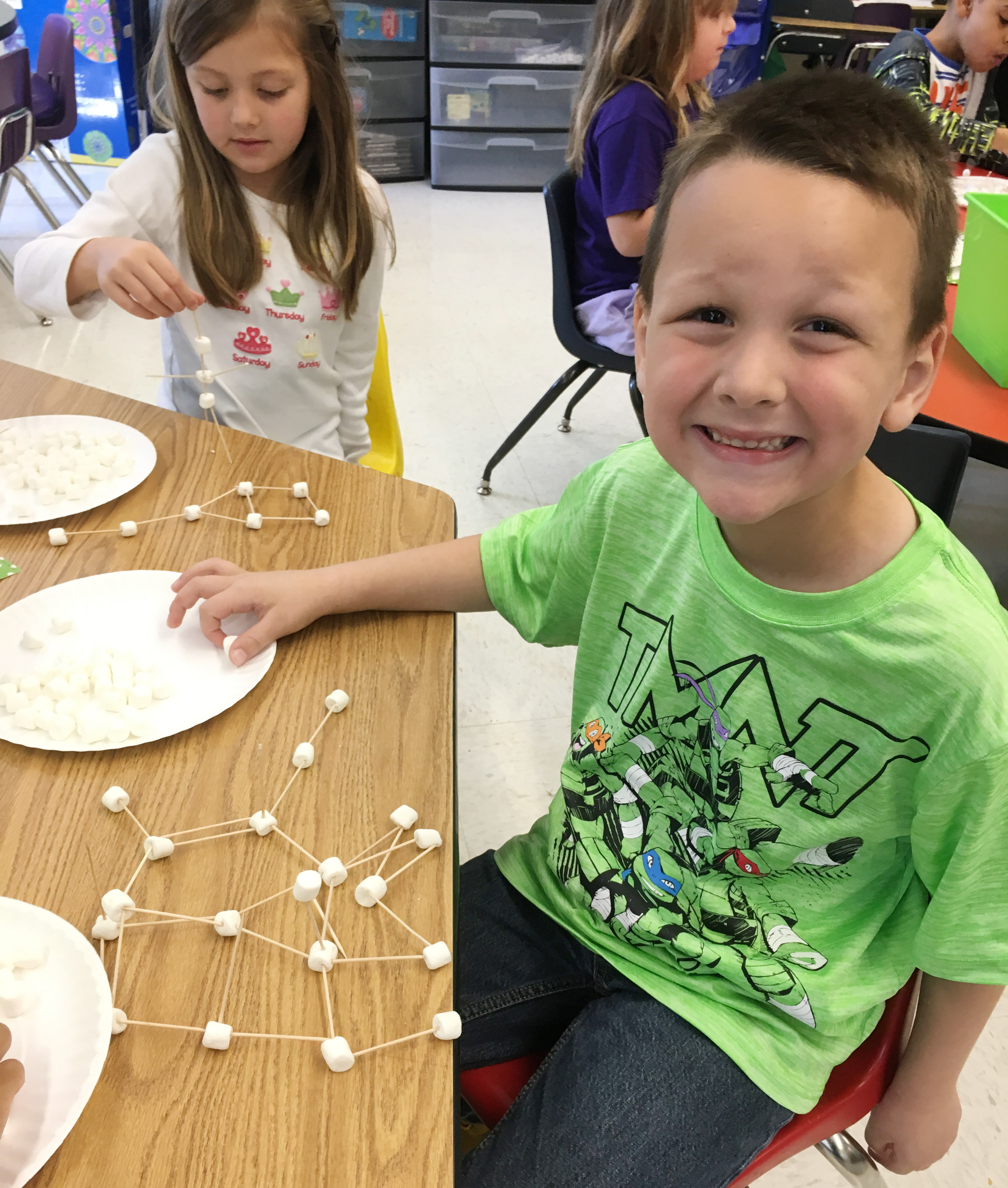 CES first-grader Justice Nelson builds his marshmallow structure.