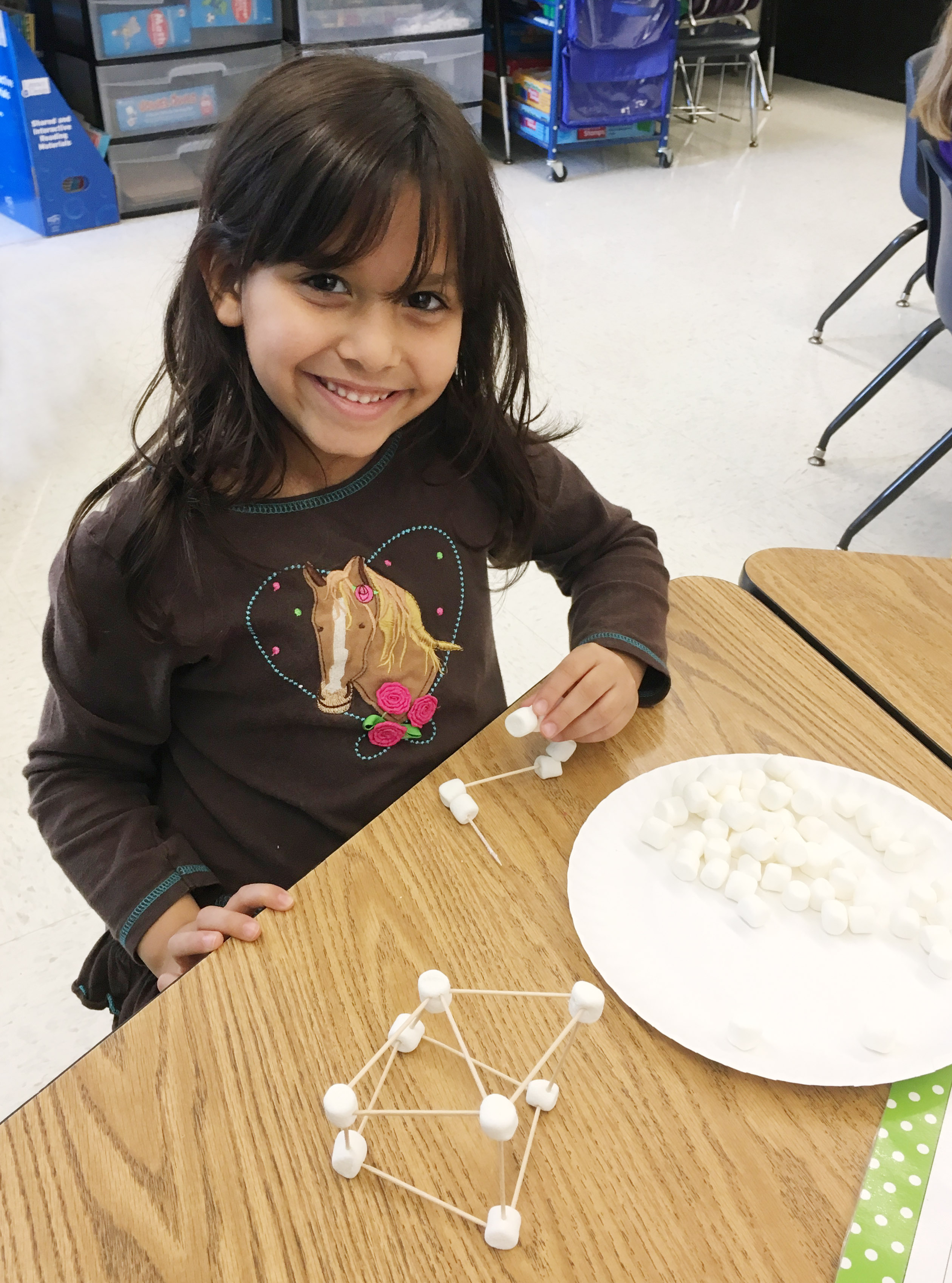 CES first-grader Carol Moura builds her marshmallow structure.