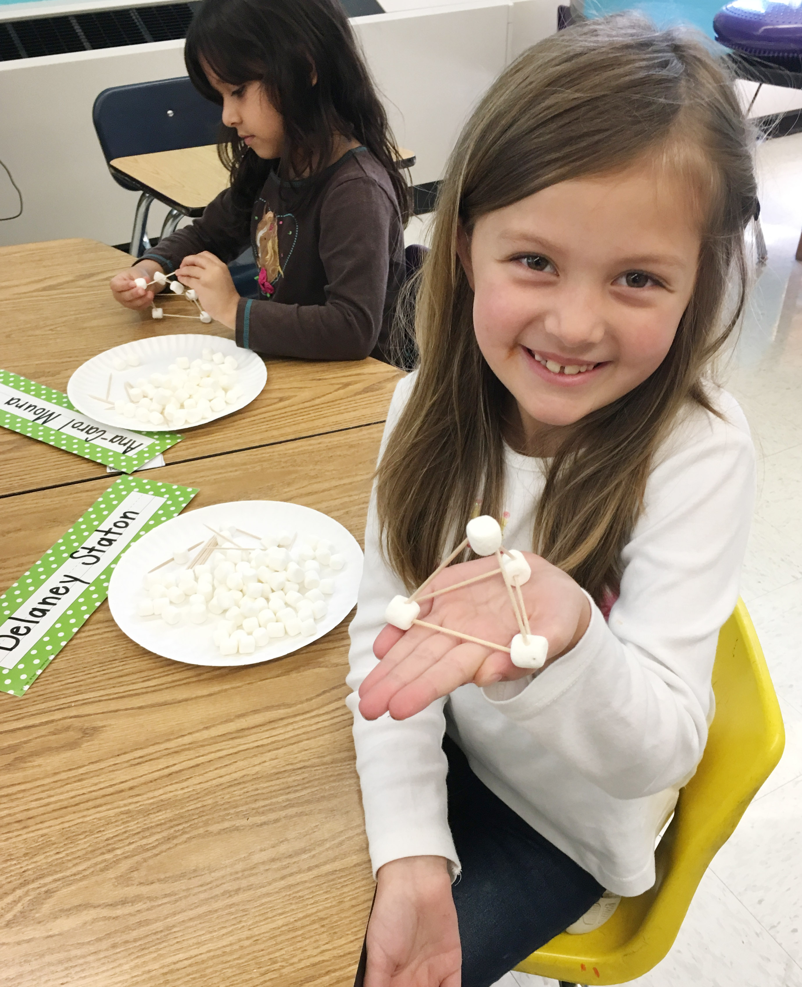 CES first-grader Delaney Station holds her marshmallow structure.