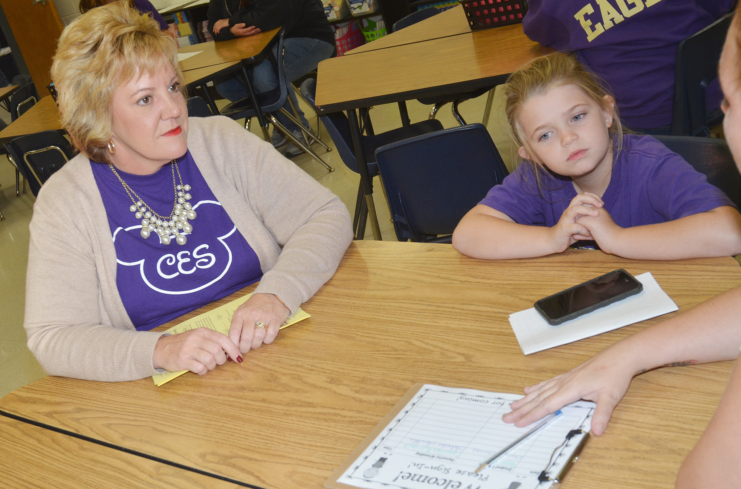 CES fourth-grade teacher Kaye Agathen talks to Chyanne Christie and her parents.