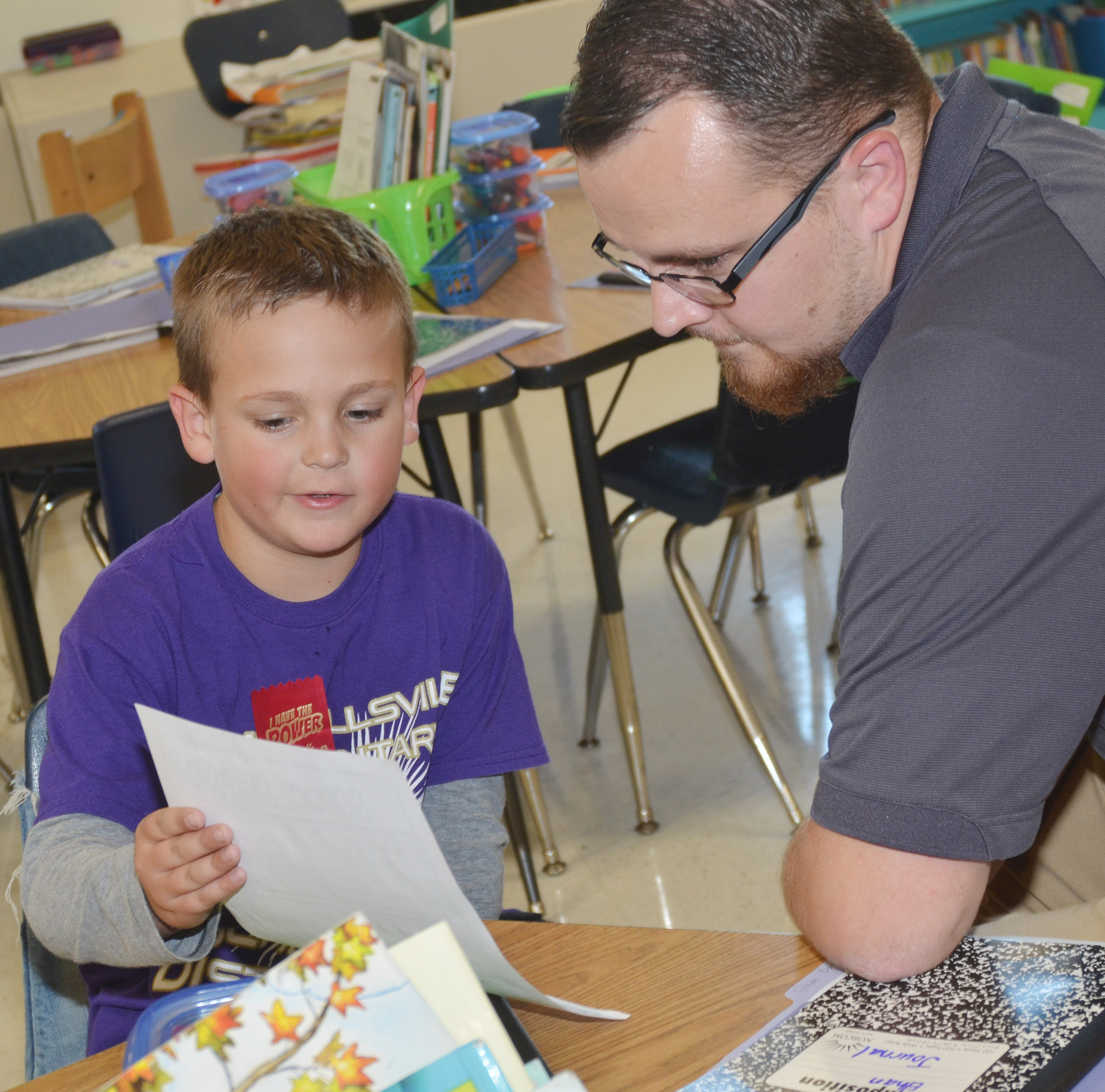 CES second-grader Brendan Martin talks to his father Ryan about his grades.