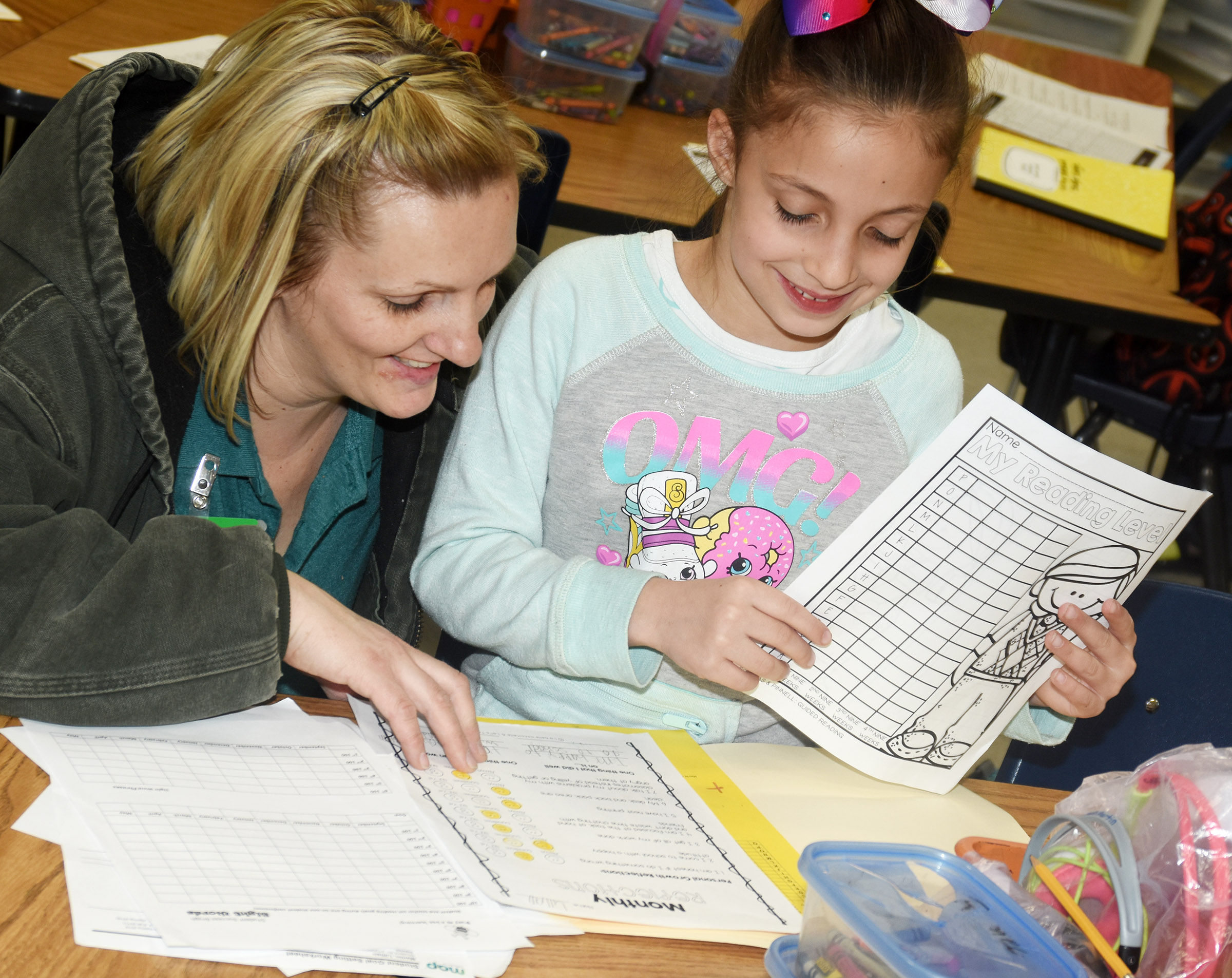CES first-grader Lillian Martin talks to her mother Danielle about her grades.