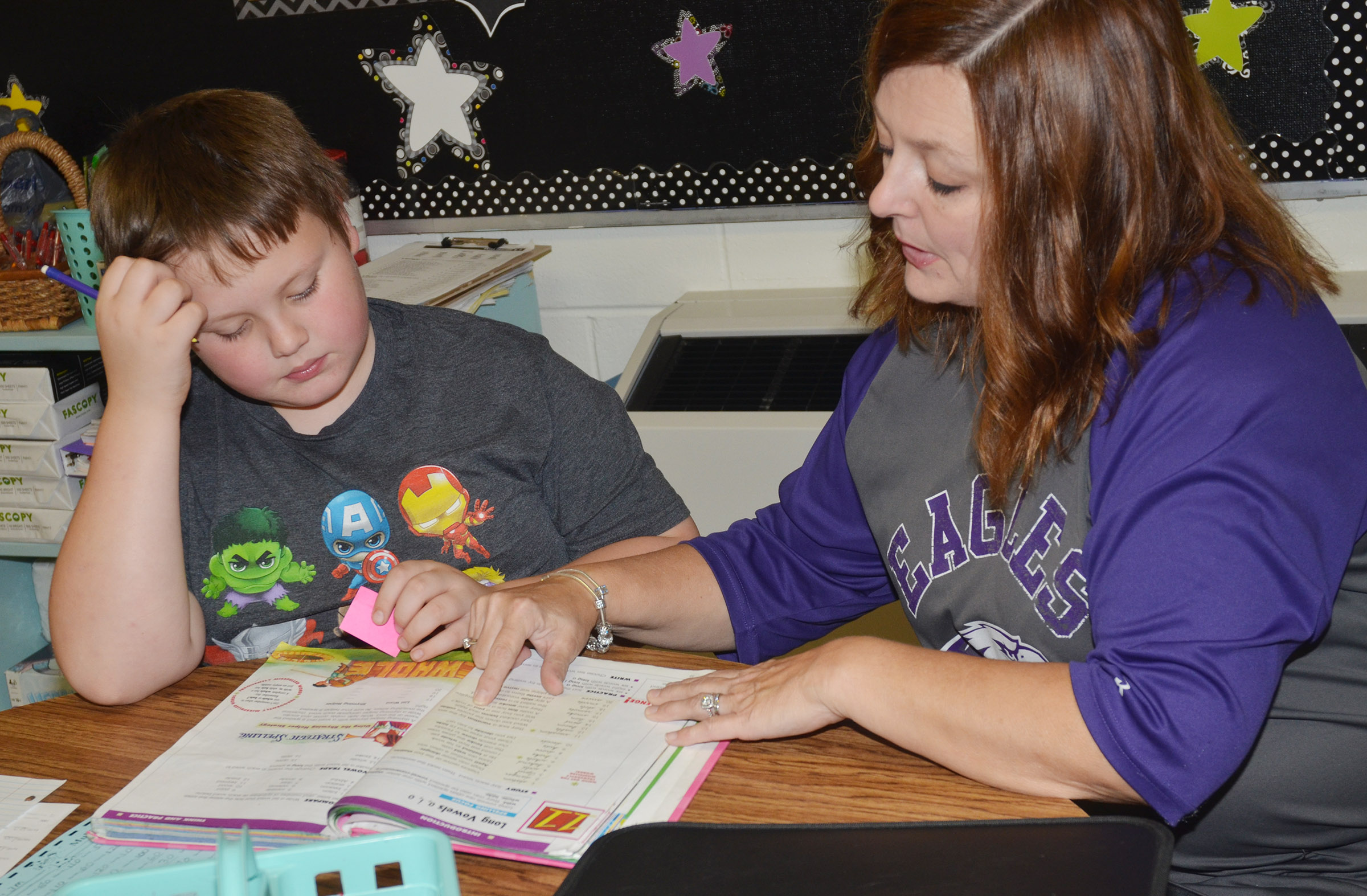 CES teacher Garnetta Murrell helps fourth-grader Jace Cox with his homework.