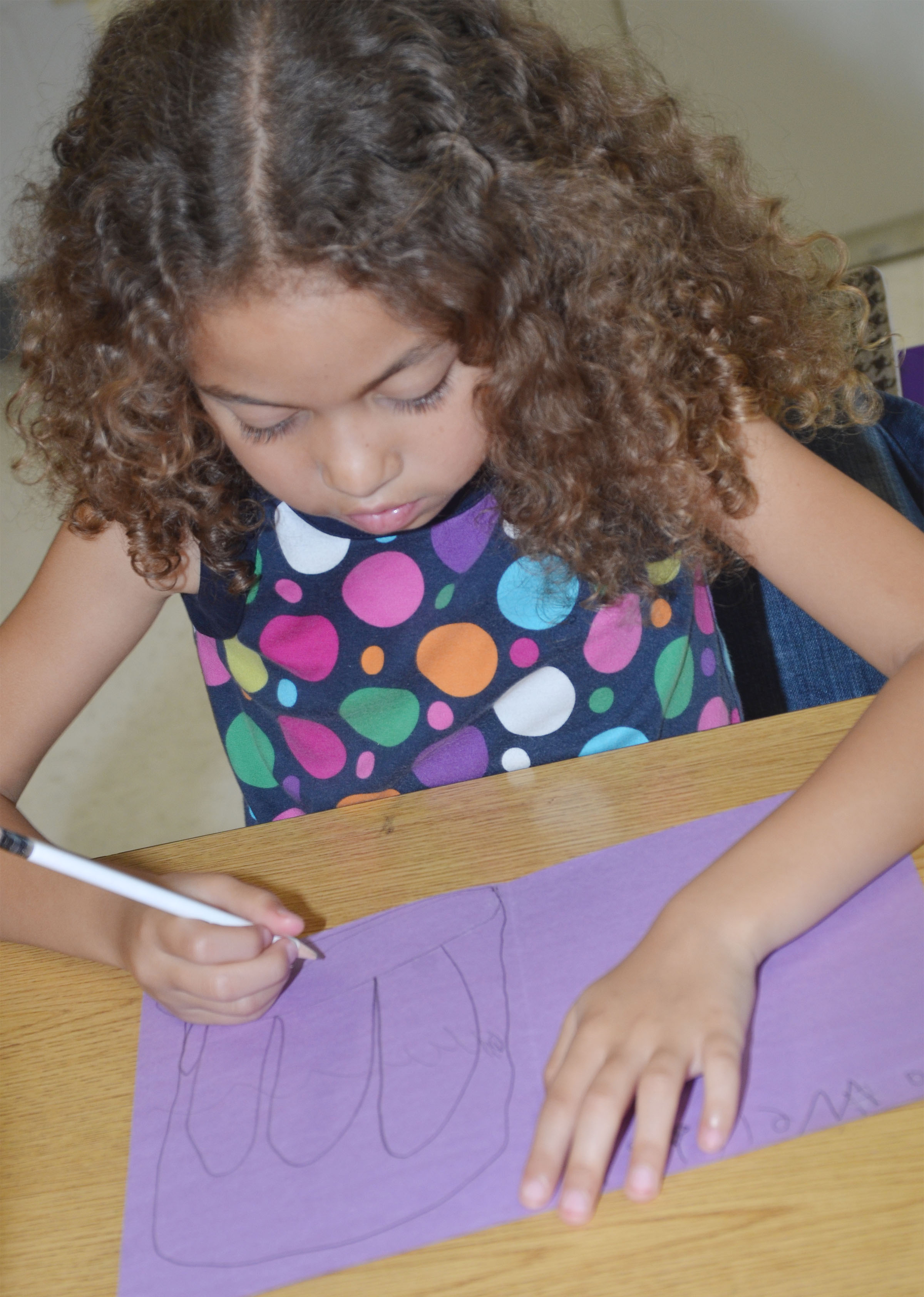 CES first-grader Londyn Smith makes a card for a third-grade student.