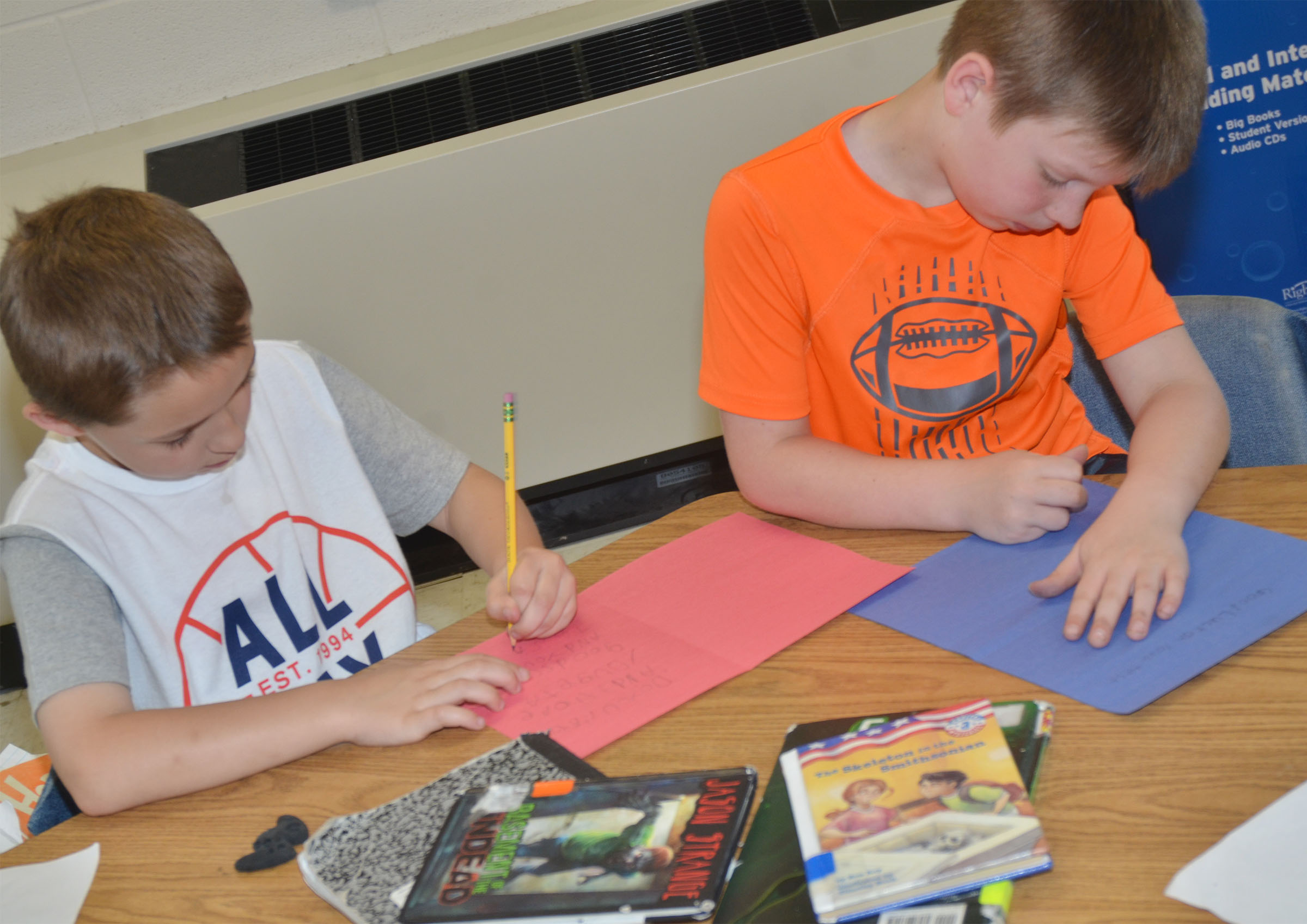 CES first-graders Aiden Forrest, at left, and Brody Sidebottom make cards for third-grade students.