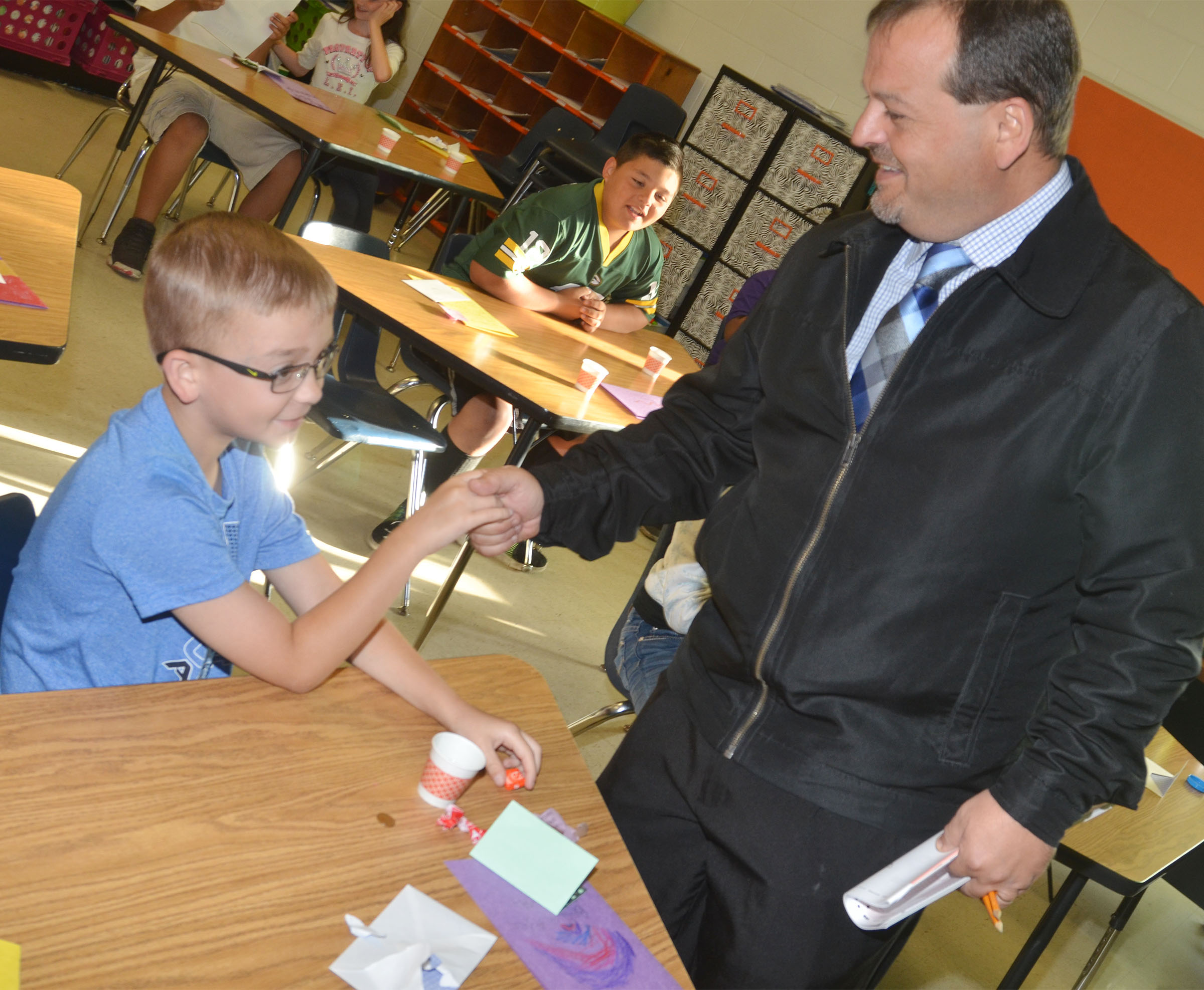 CES Principal Ricky Hunt wishes third-grader Cameron Estes good luck on his test.