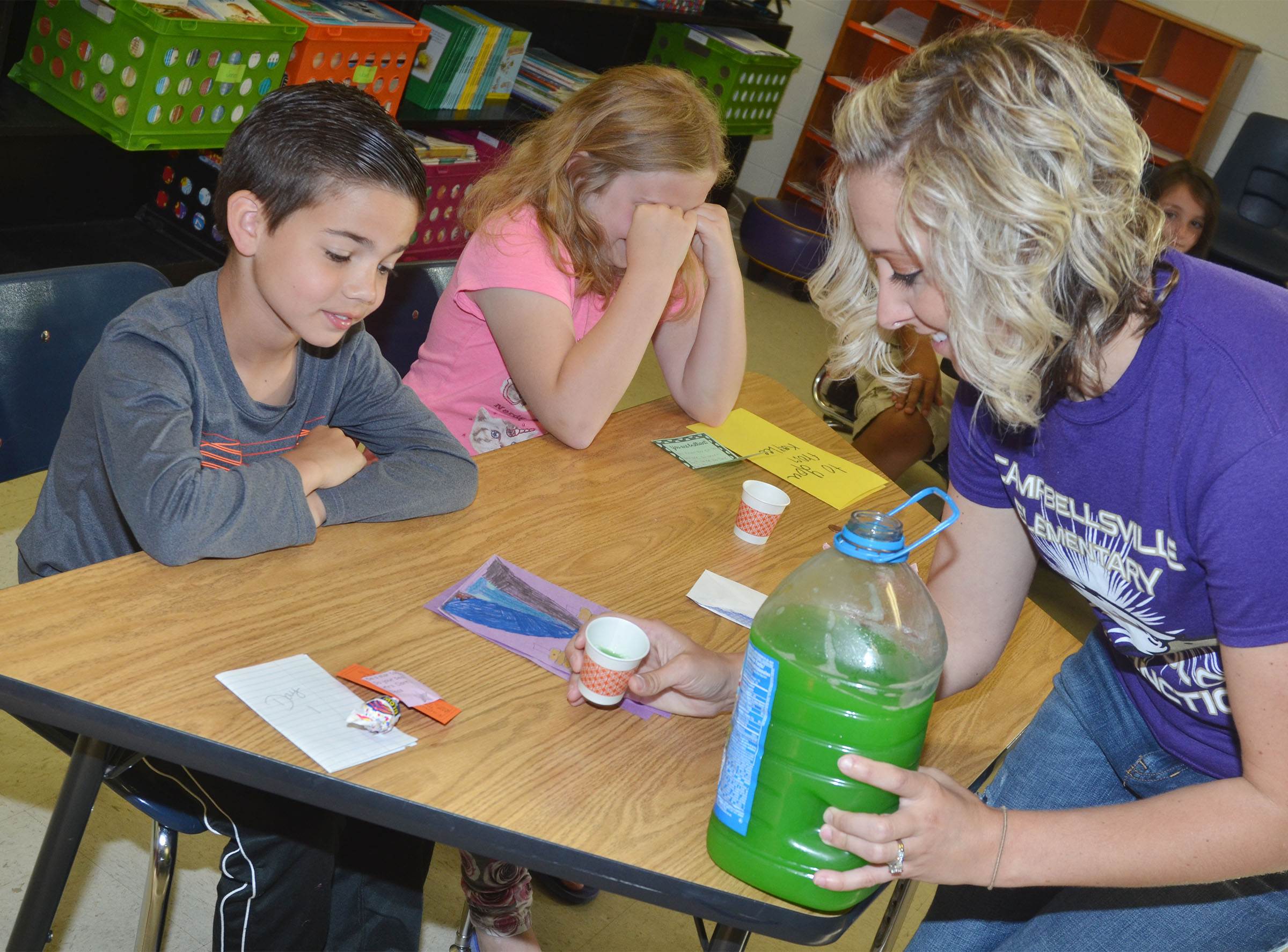 "CES third-grade teacher Hannah Jones gives Easton Williams, at left, and Arianna Childers their ""brain juice."""