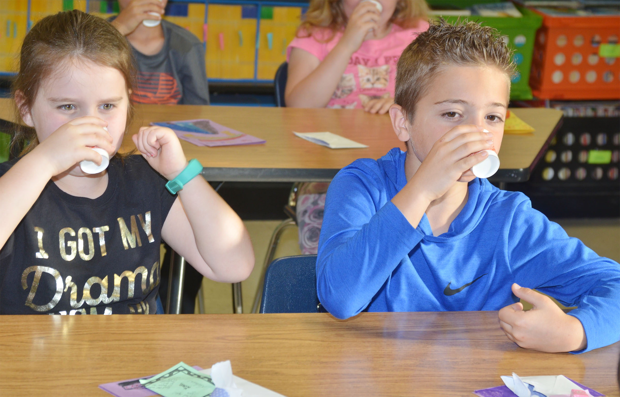 "CES third-graders Maylee Wilds, at left, and Carson Mills drink their ""brain juice."""