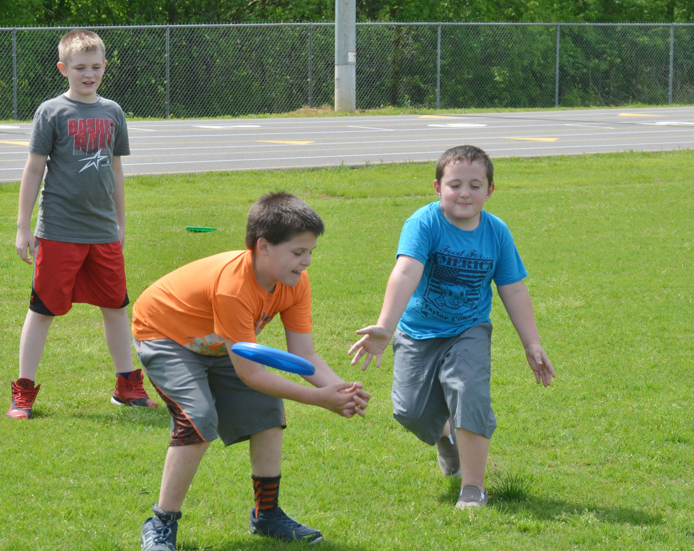 CES third-grader Chris Brown catches a Frisbee.