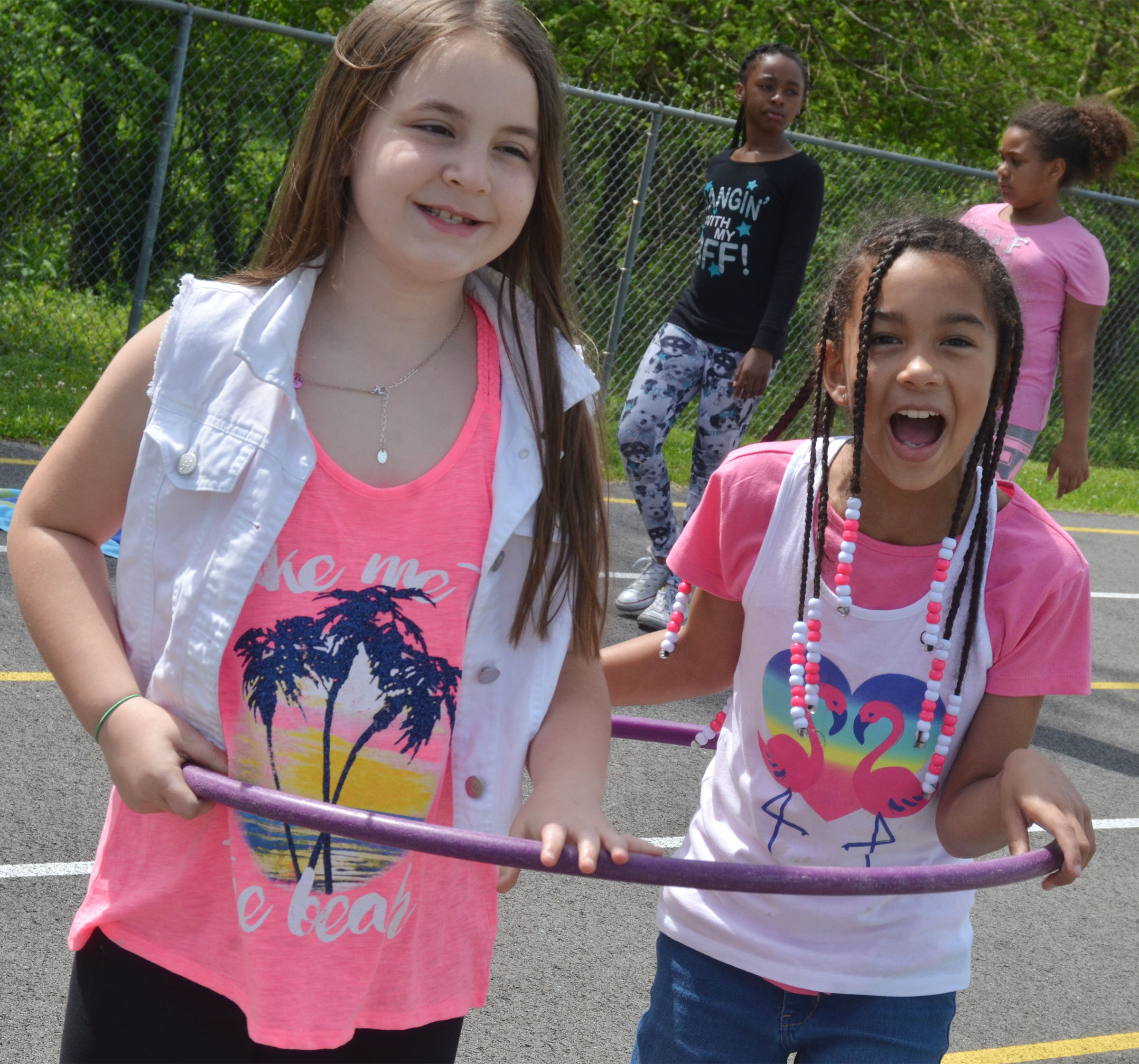 CES third-graders Alexis Roddy, at left, and De'Asia Fisher share a hula hoop.