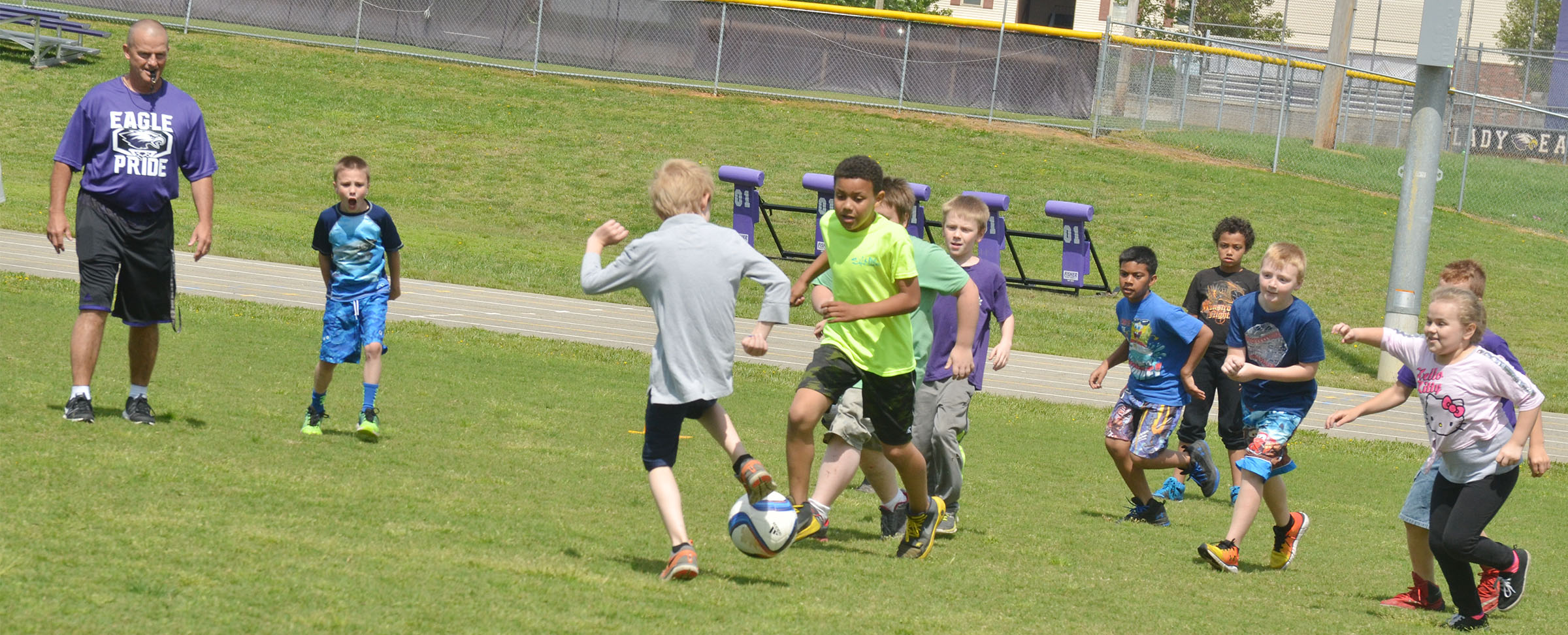 CES third-graders battle in a soccer game.